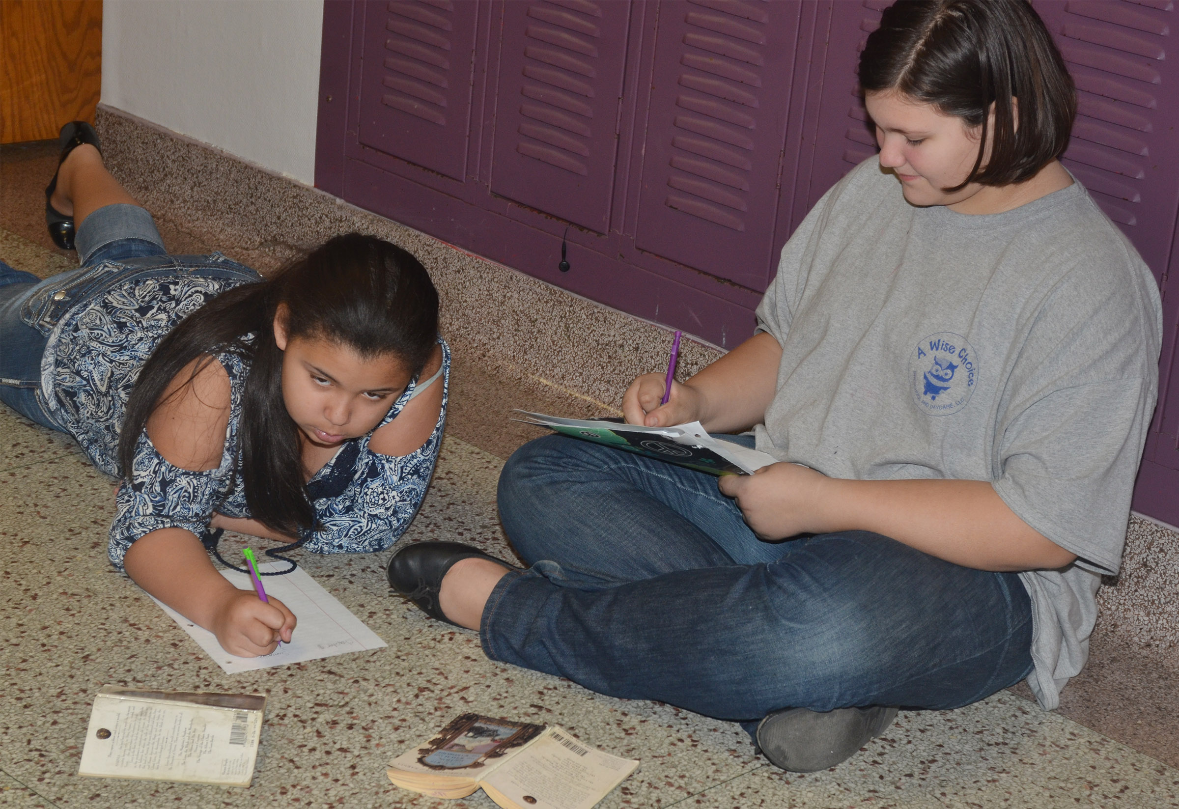 "CMS fifth-graders Kyleigh Richerson, at left, and Allison Sumners write about ""The Lion, the Witch and the Wardrobe."""