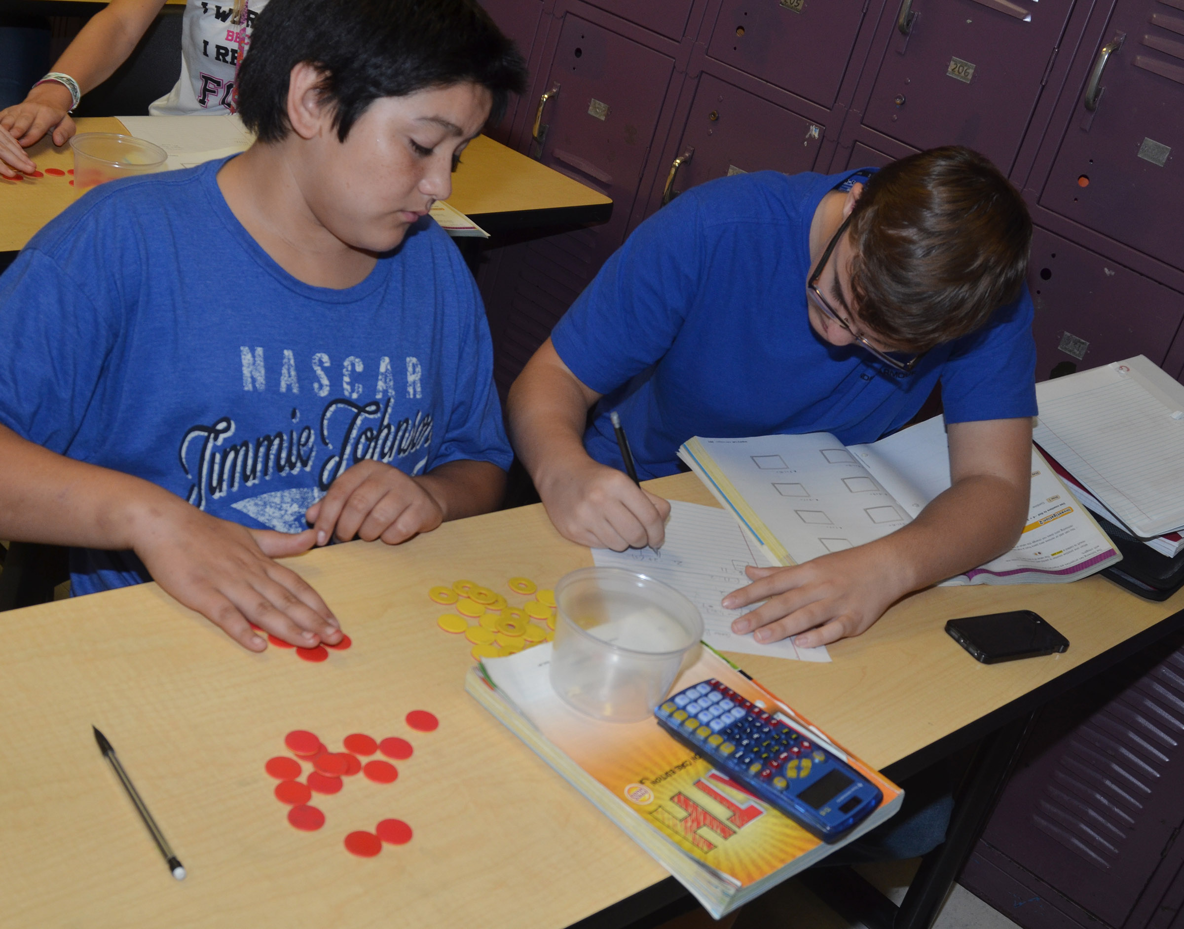 CMS seventh-graders Cayden Corona, at left, and Connor Byrd work a math problem using their counters.