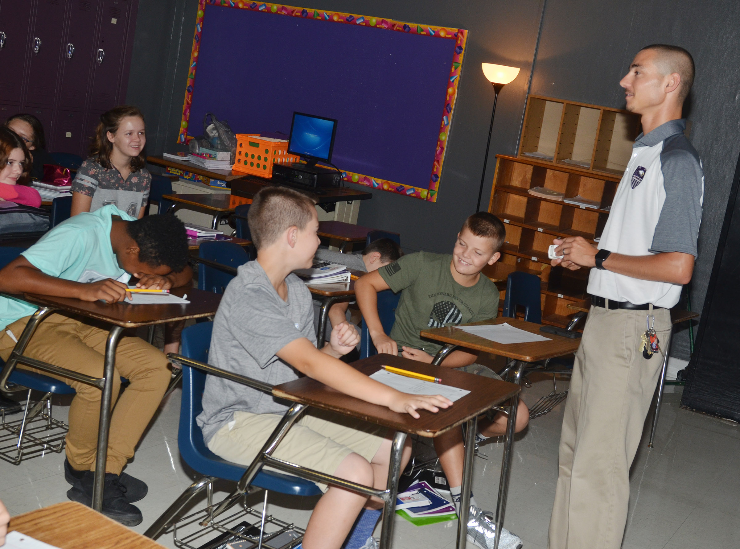 CMS teacher Bradley Harris shares three facts about himself with his leadership students, one of which is a lie.