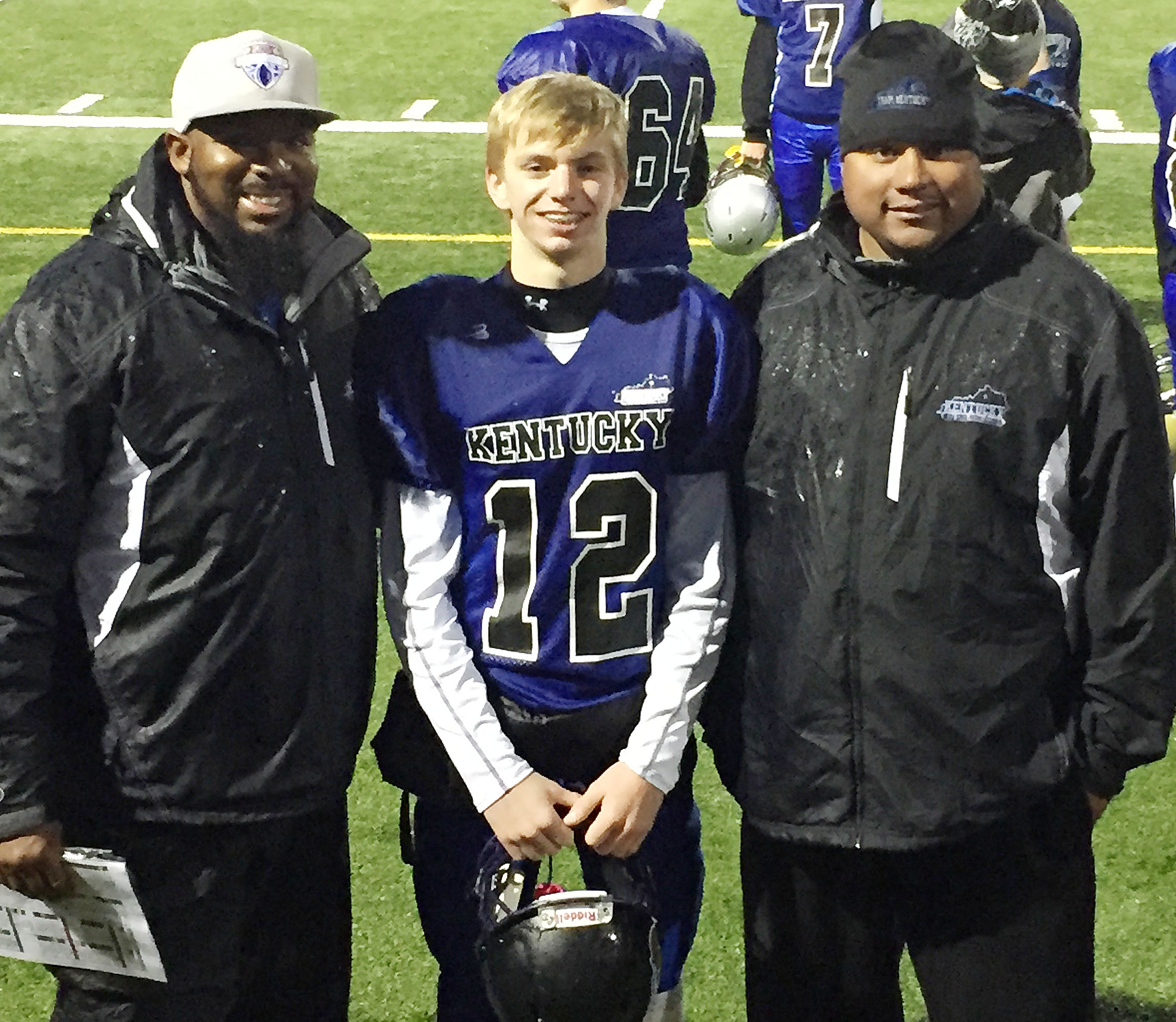 Campbellsville Middle School eighth-grader and football player Arren Hash was named to Football University's national Team Kentucky, and the team has won all of its games, to advance to the nationals. Will Griffin, at left, and Bronson Gowdy, who help coach the CMS football team, are offensive coordinator for the team and coordinator for FBU, respectively.