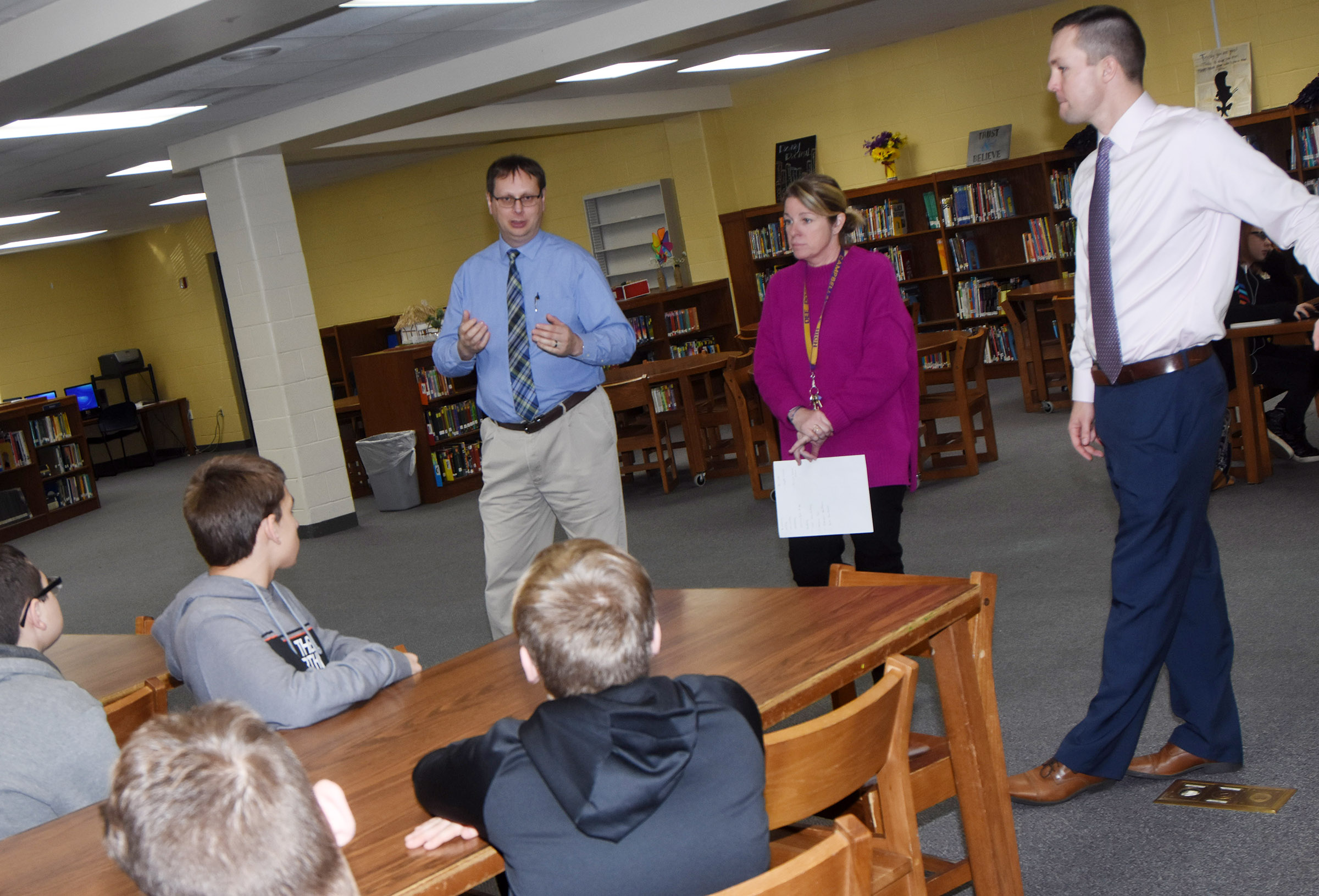 From left, CHS Guidance Counselor Richard Dooley, College and Career Readiness Counselor Dee Doss and Principal Weston Jones talk to CMS eighth-graders about what they can expect when attending high school.