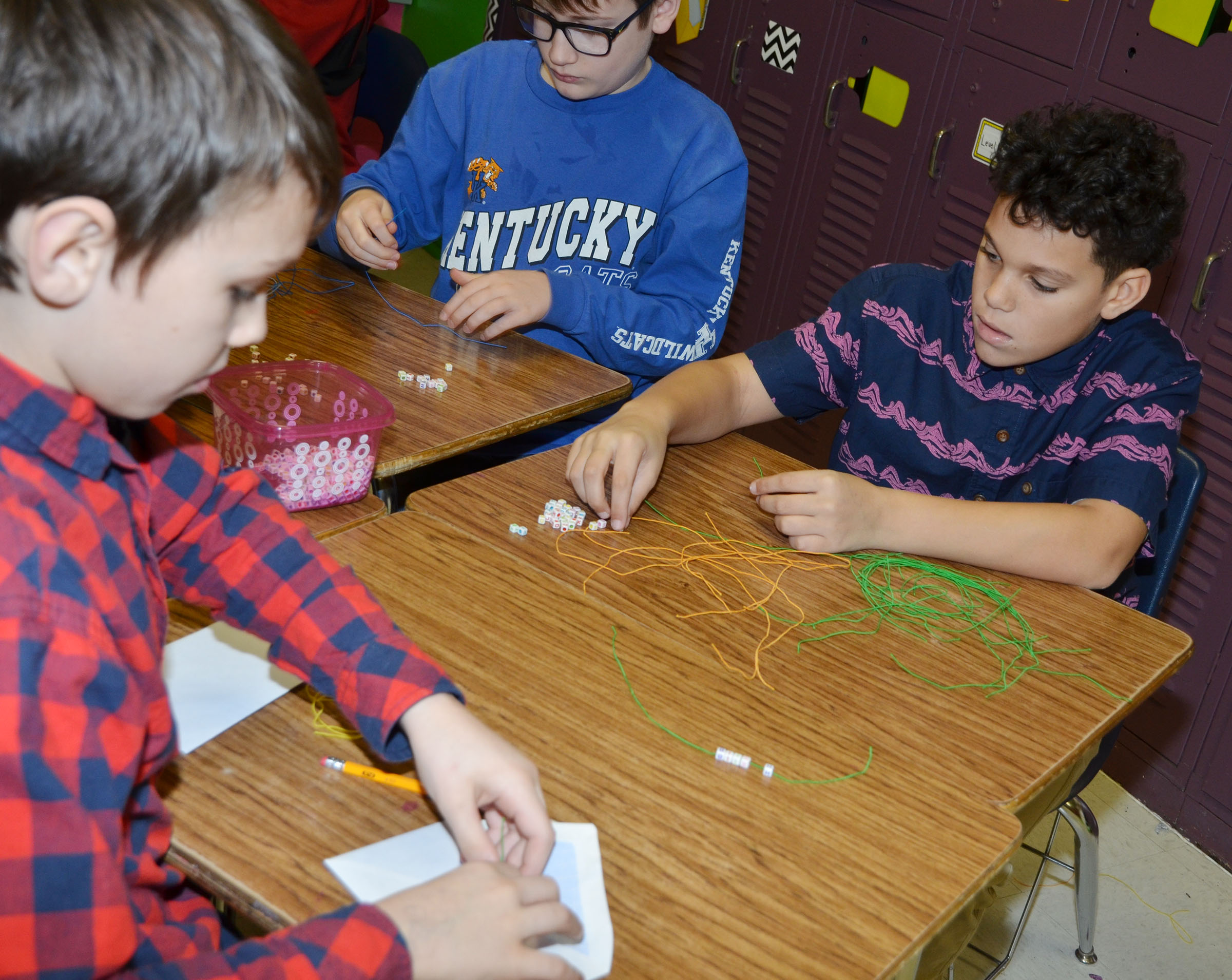 From left, CMS sixth-graders Logan Wilson, Brady Hoosier and Kaydon Taylor make bracelets.