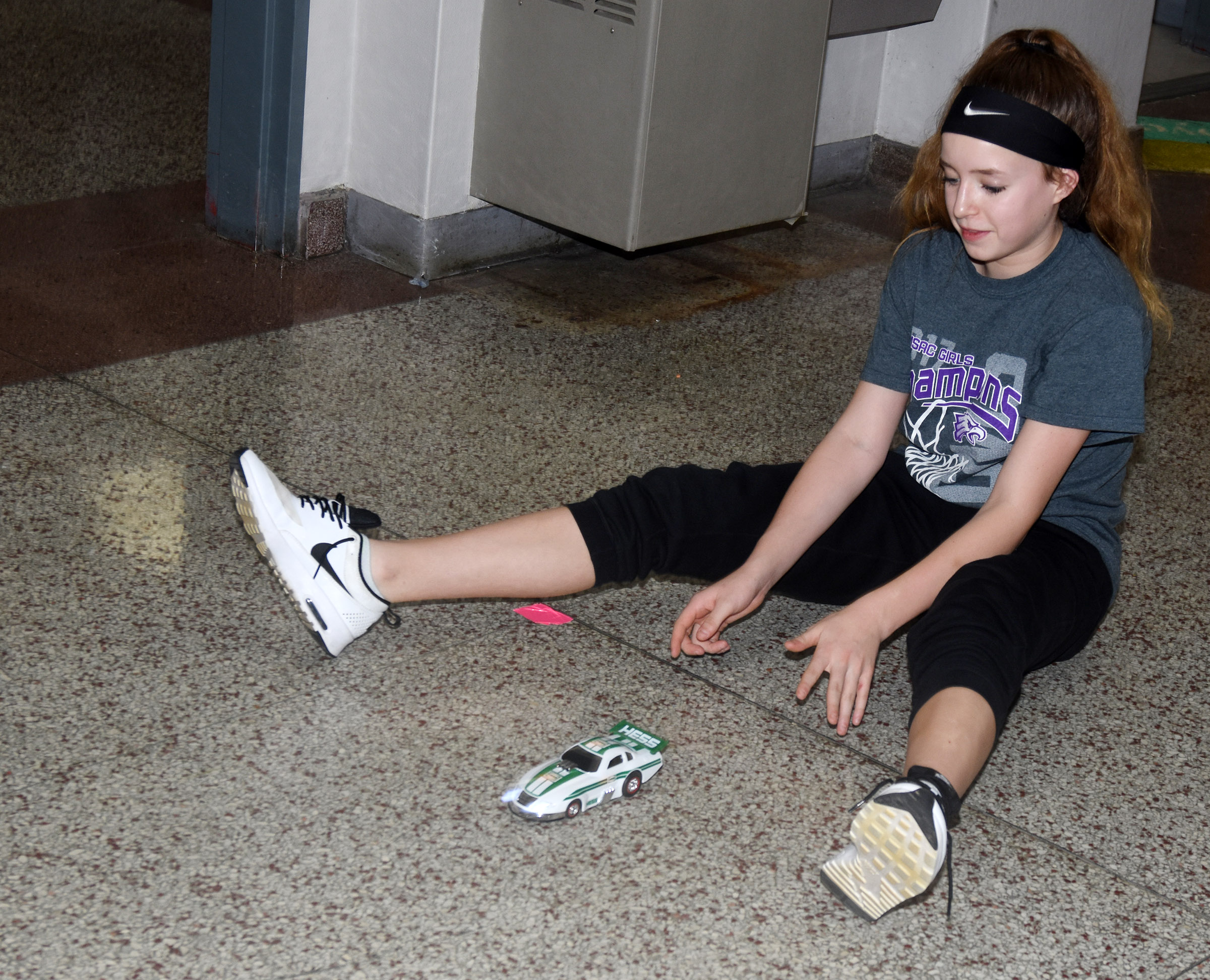 CMS eighth-grader Rylee Petett works to calculate speed as she tests a model car.