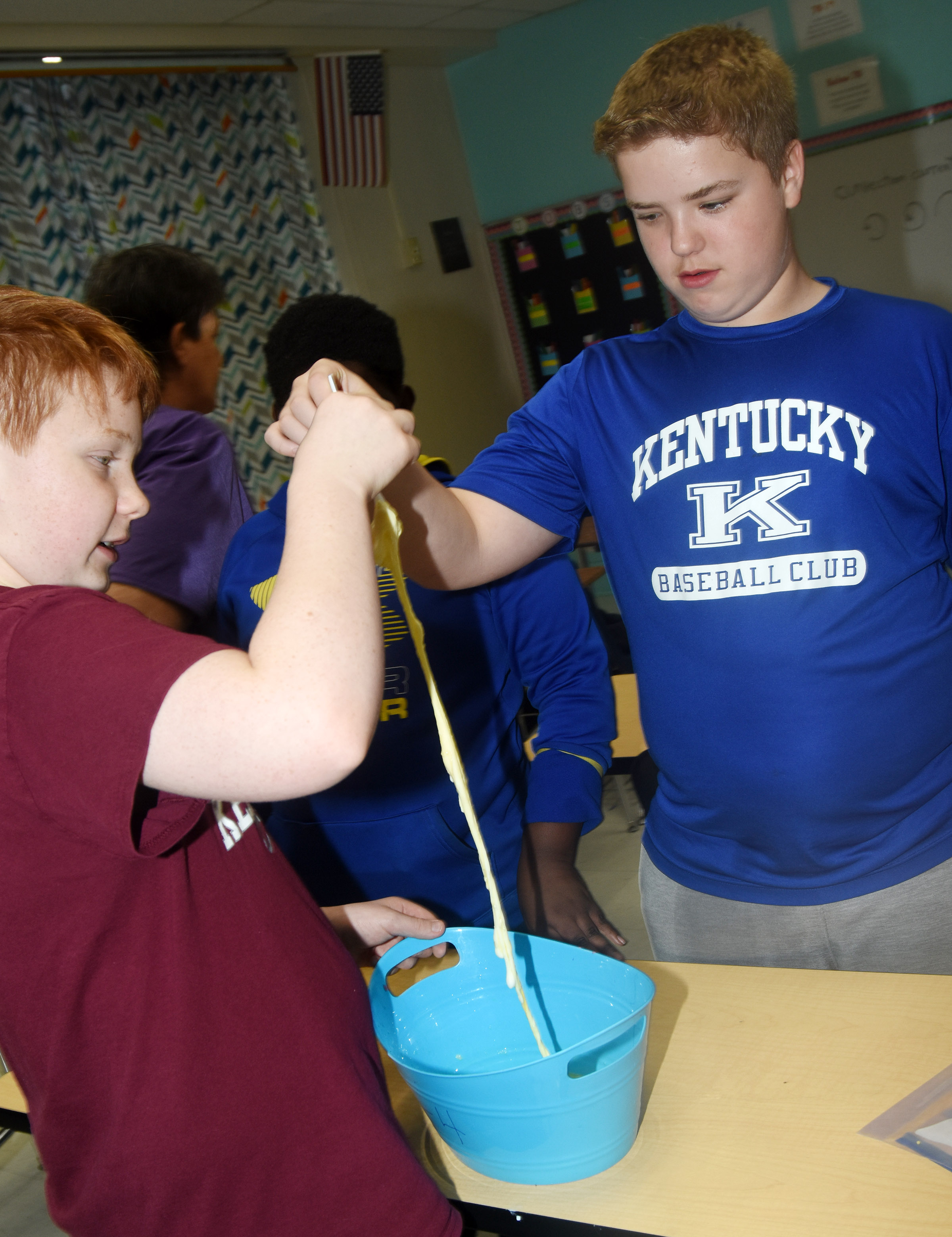 CMS sixth-graders Conner Rinehart, at left, and Ryan Grubbs mix their slime together.