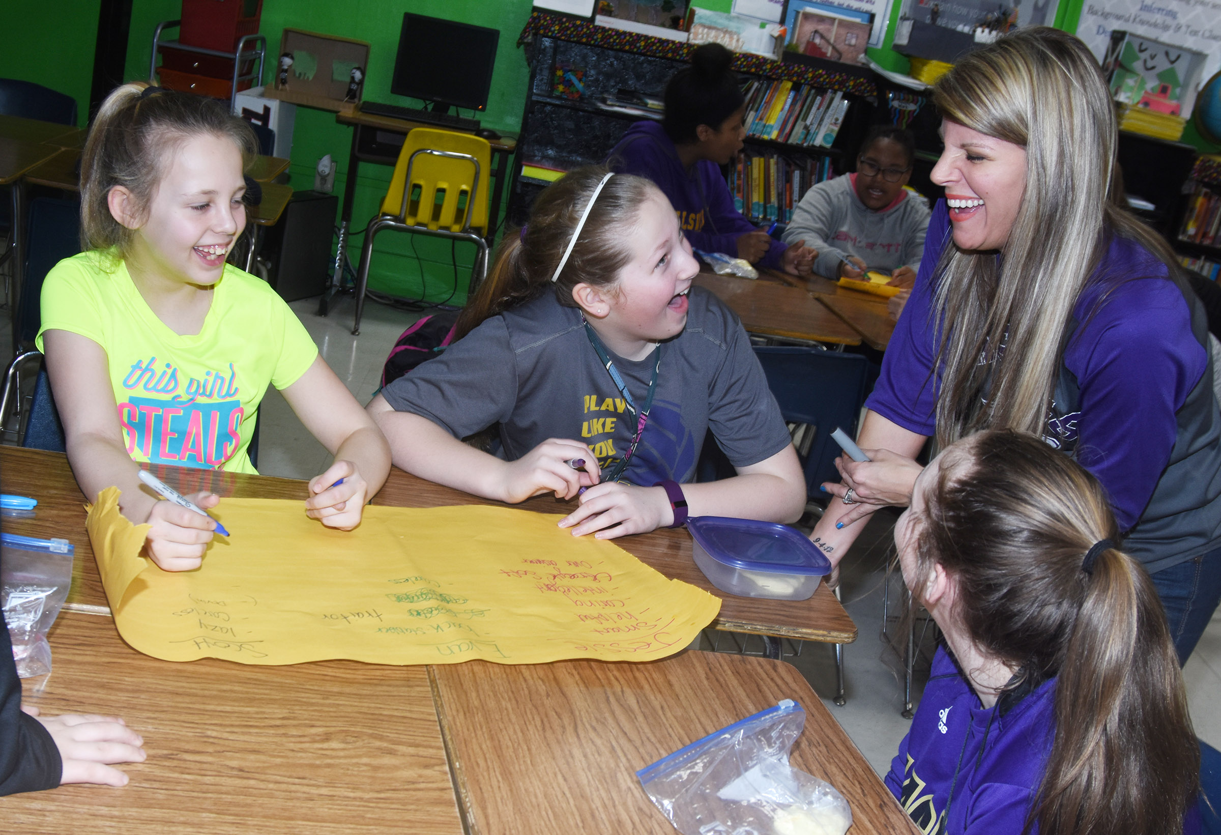 CMS sixth-grade teacher Andrea Gribbins works with, from left, Gabby Bright, Ava Hughes and CheyAnn Edwards in a reading session.