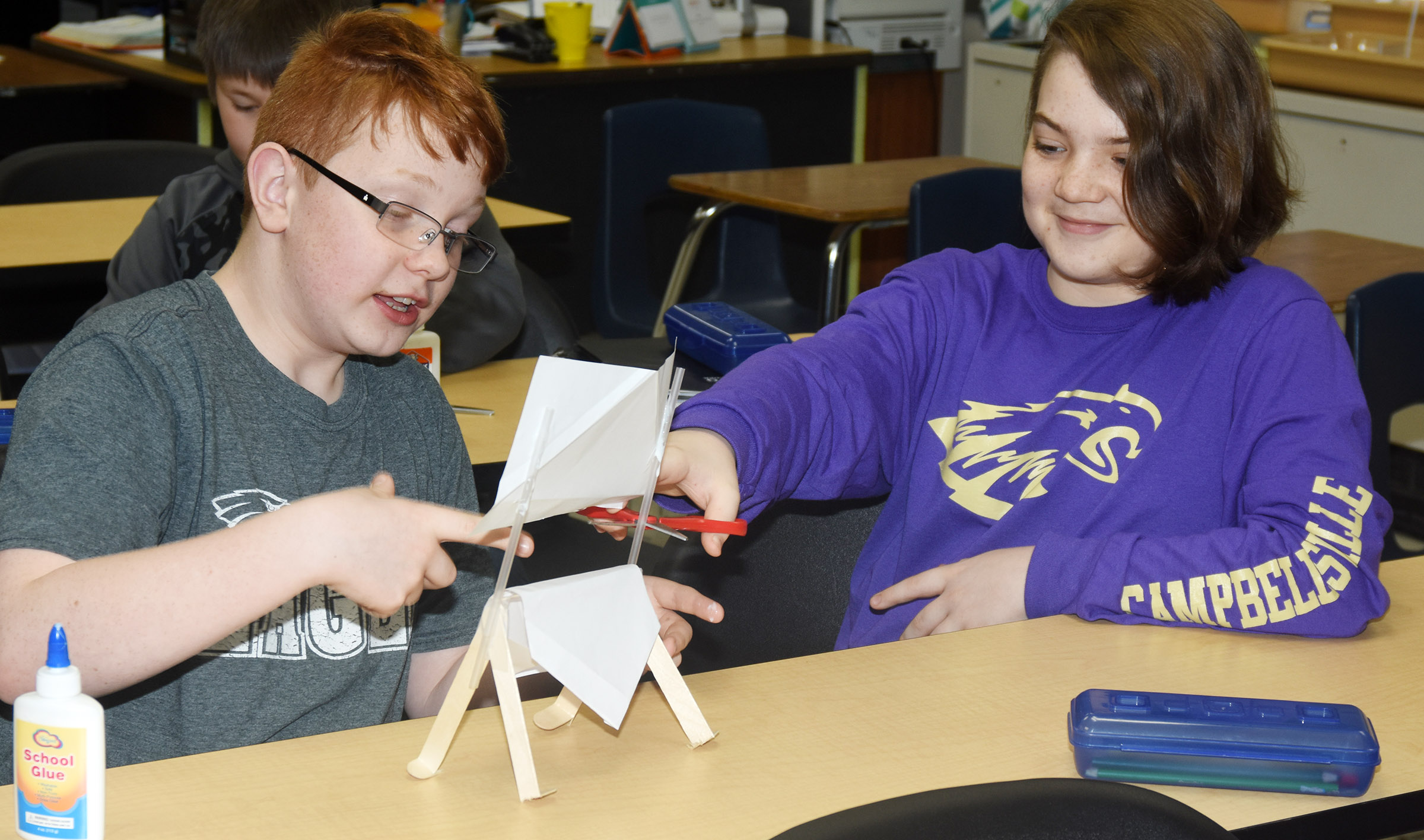 CMS sixth-graders Conner Rinehart, at left, and Kayden Birdwell build a lemonade stand.