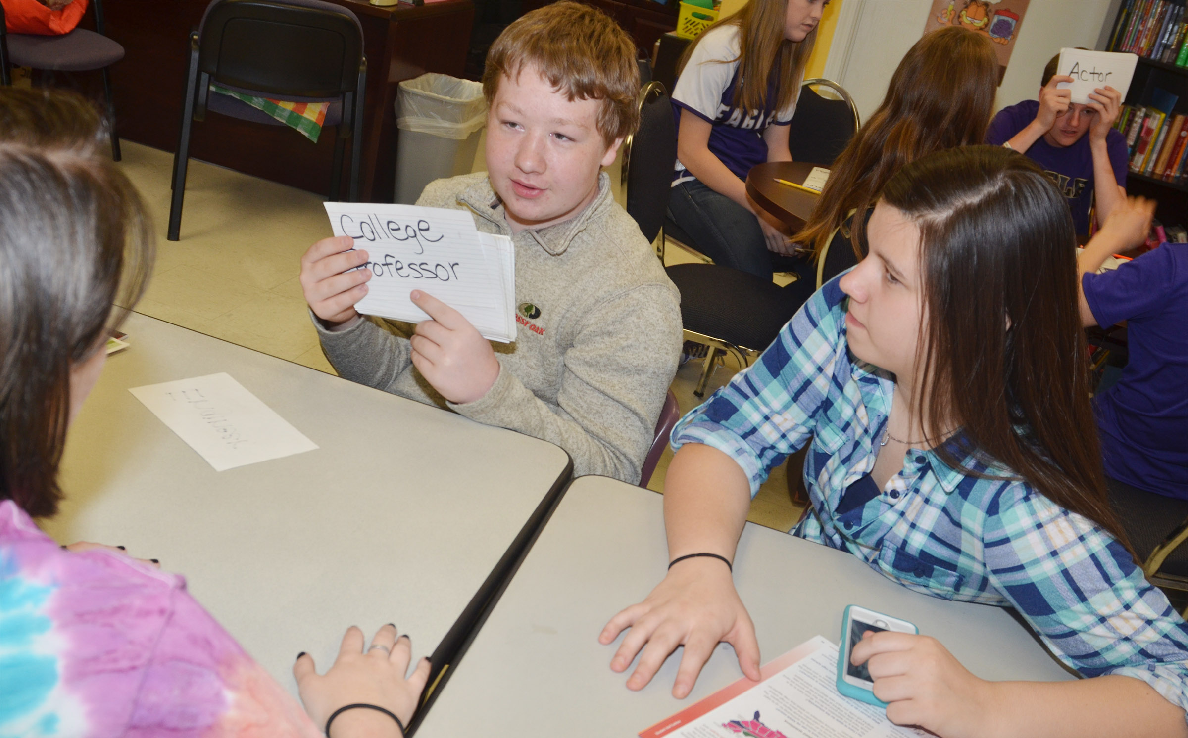 CMS eighth-grader Ryan Milburn tires to guess which career his classmates are giving him clues about.