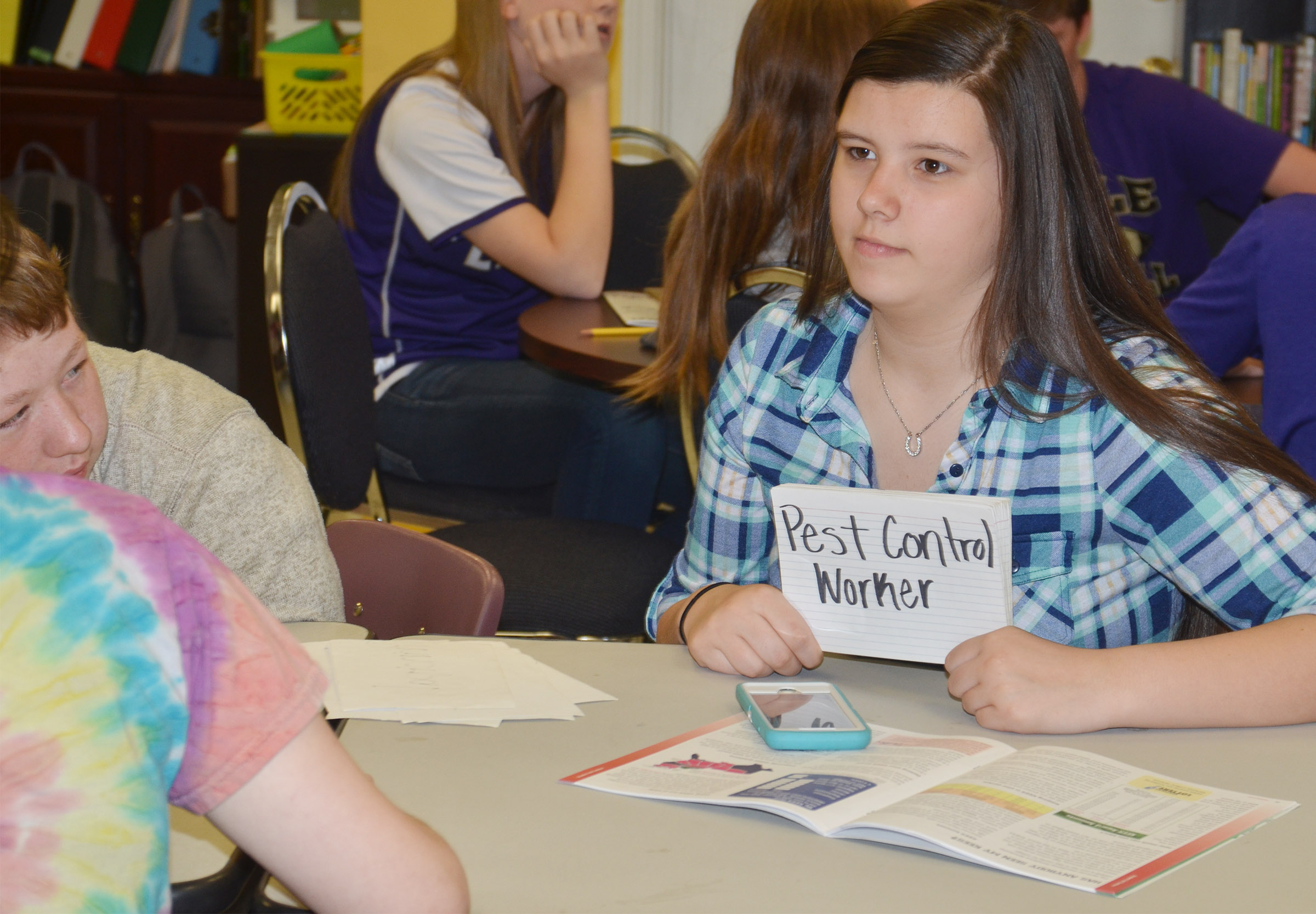 CMS eighth-grader Hannah Keith tries to guess which career his classmates are giving him clues about.