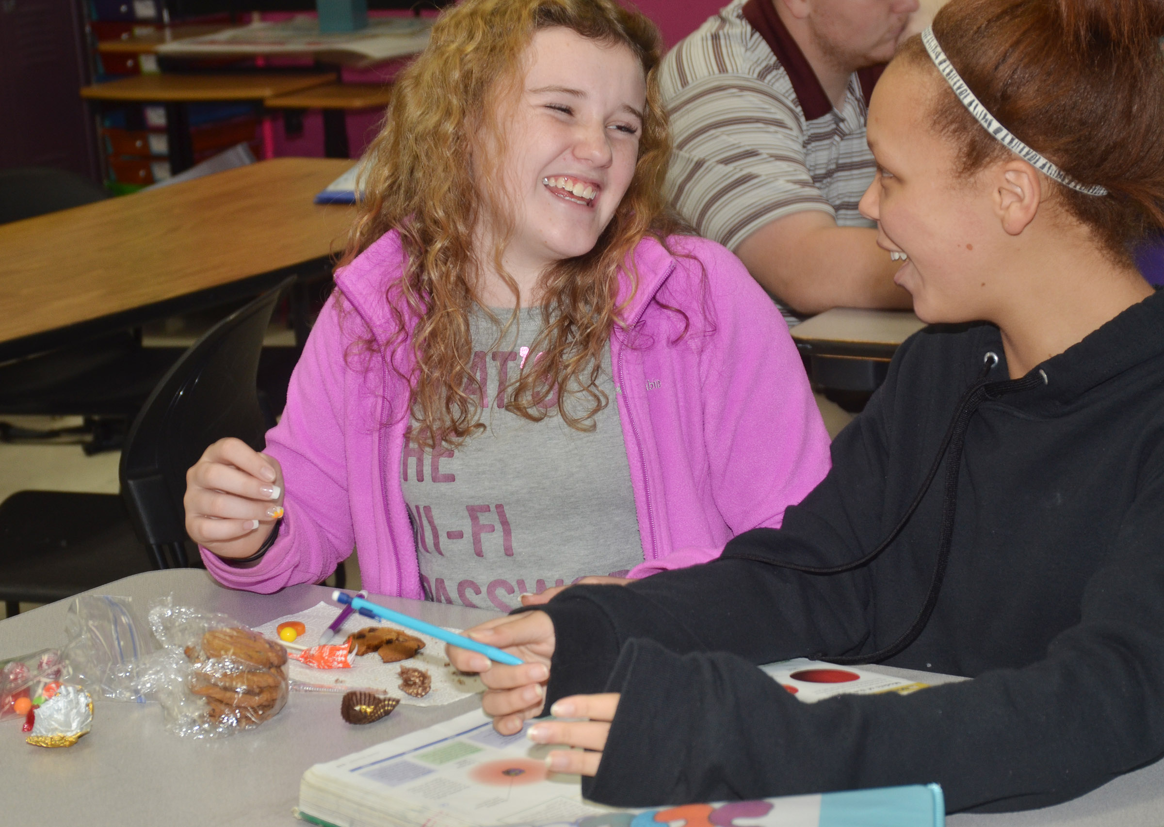 CMS eighth-graders Abigail Brisko, at left, and Kitanta Taylor laugh as they complete their assignment.