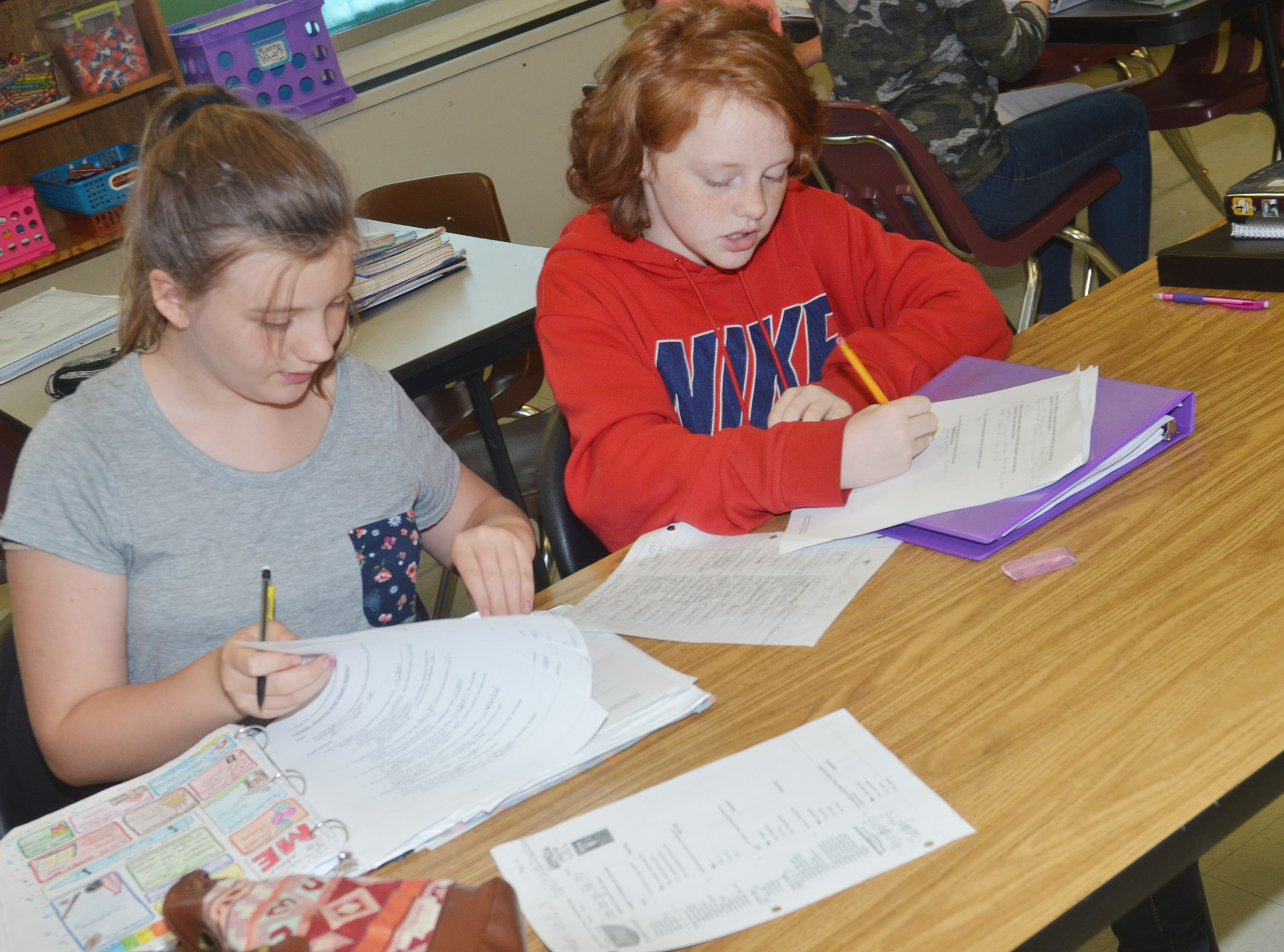 CMS seventh-graders Mikaela Scharbrough, at left, and Haley Gutierrez complete their study guide together.