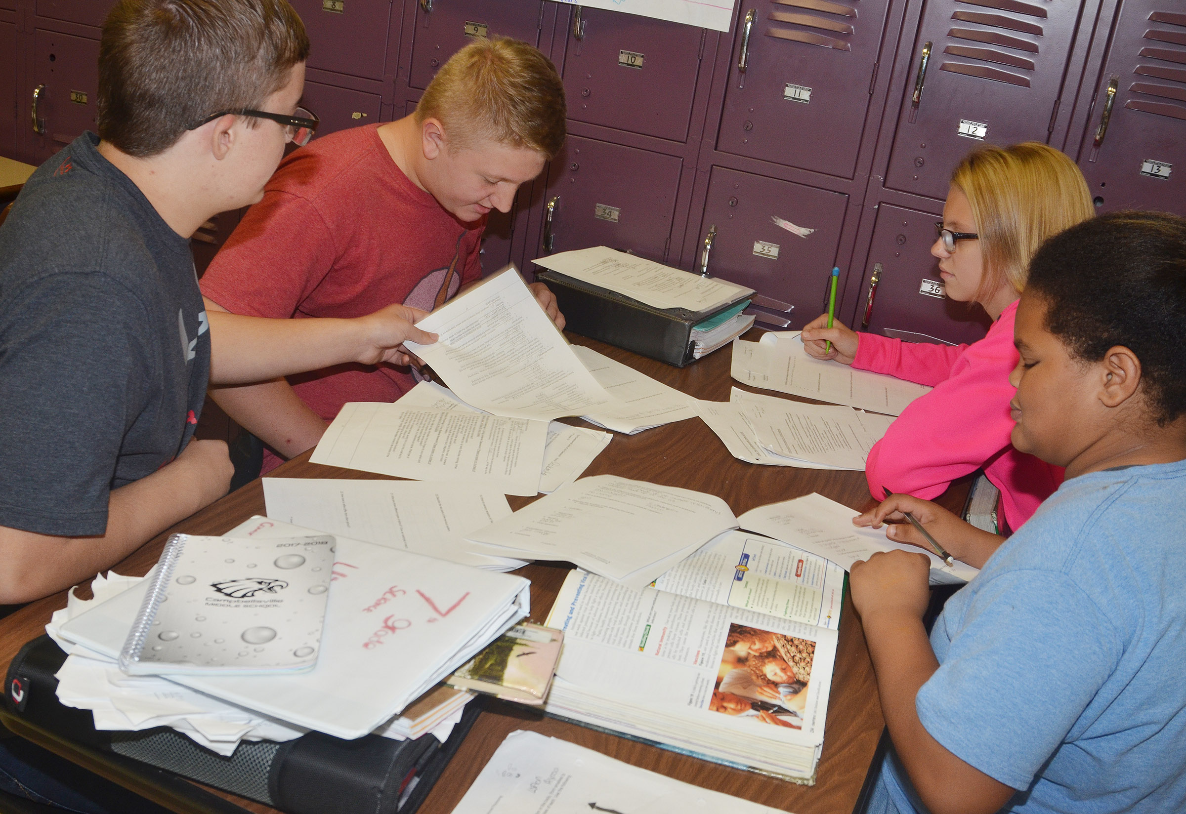 From left, CMS seventh-graders Connor Byrd, Levi Dicken, Jade Wheeler and Alissa Lofton work together as they study.