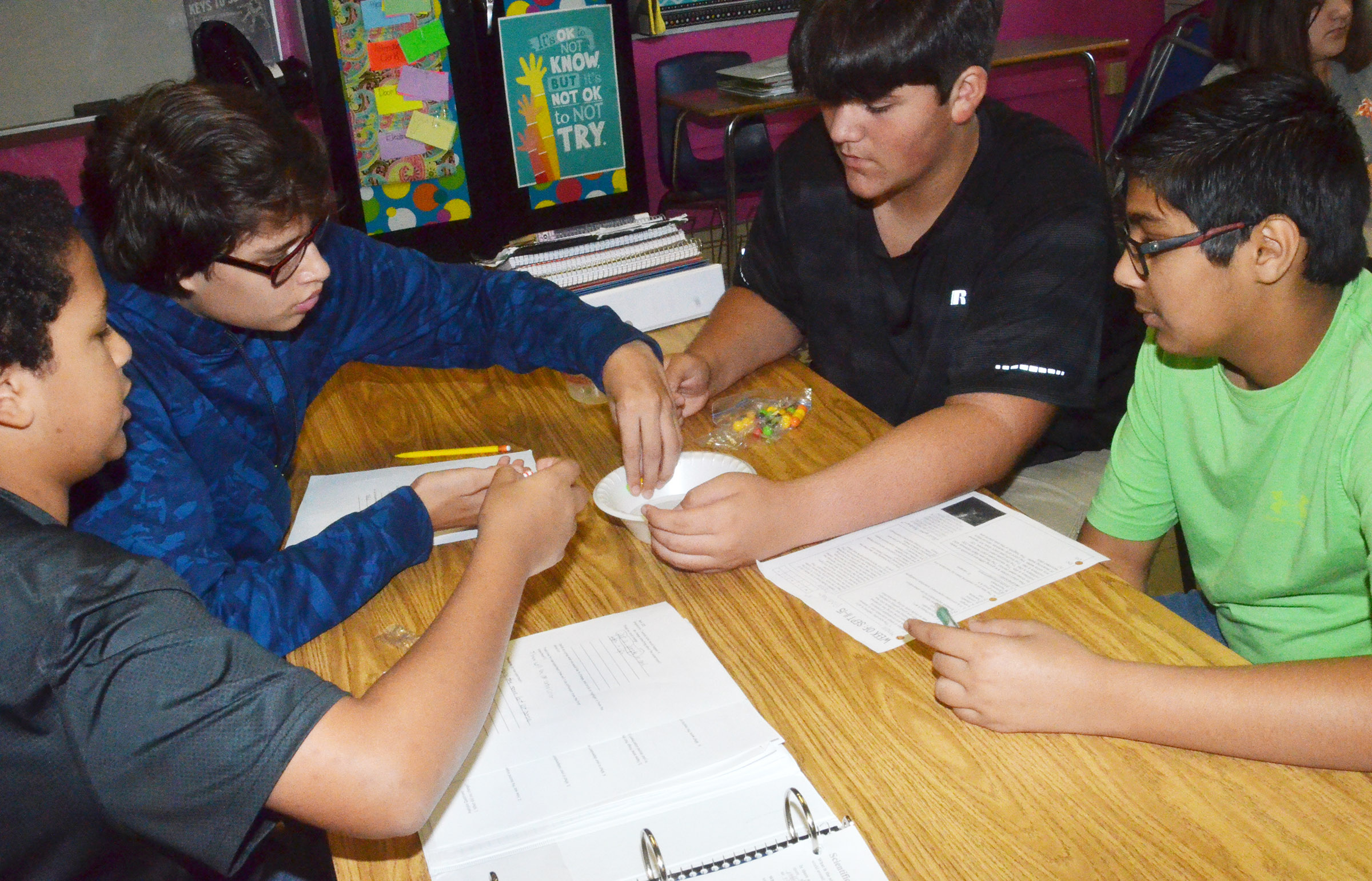From left, CMS eighth-graders Tezon Mitchell, Nate Arachi, Logan Rakes and Yash Patel perform their lab exercise.