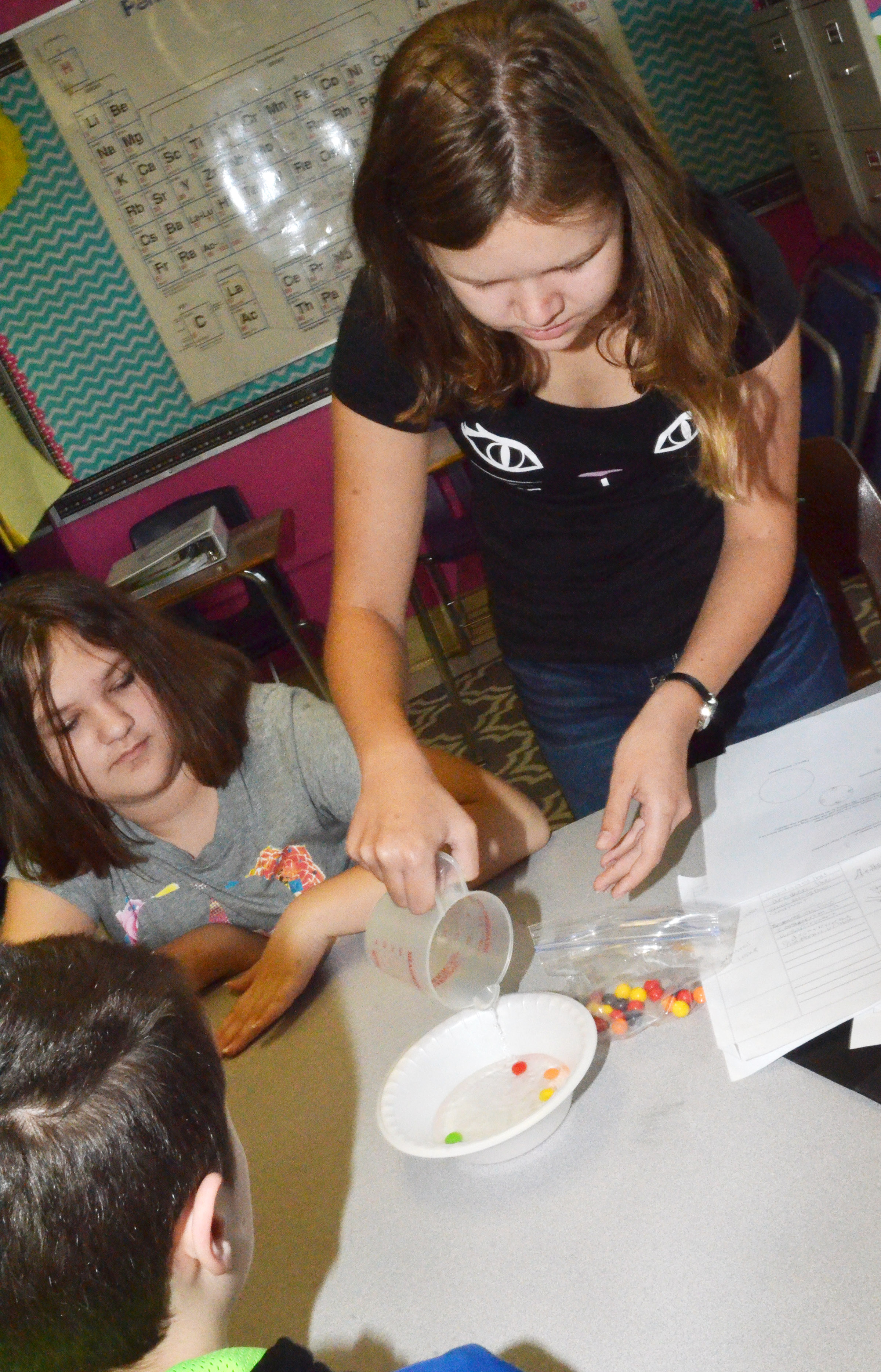CMS eighth-grader MaCayla Falls pours water into her group's bowl.