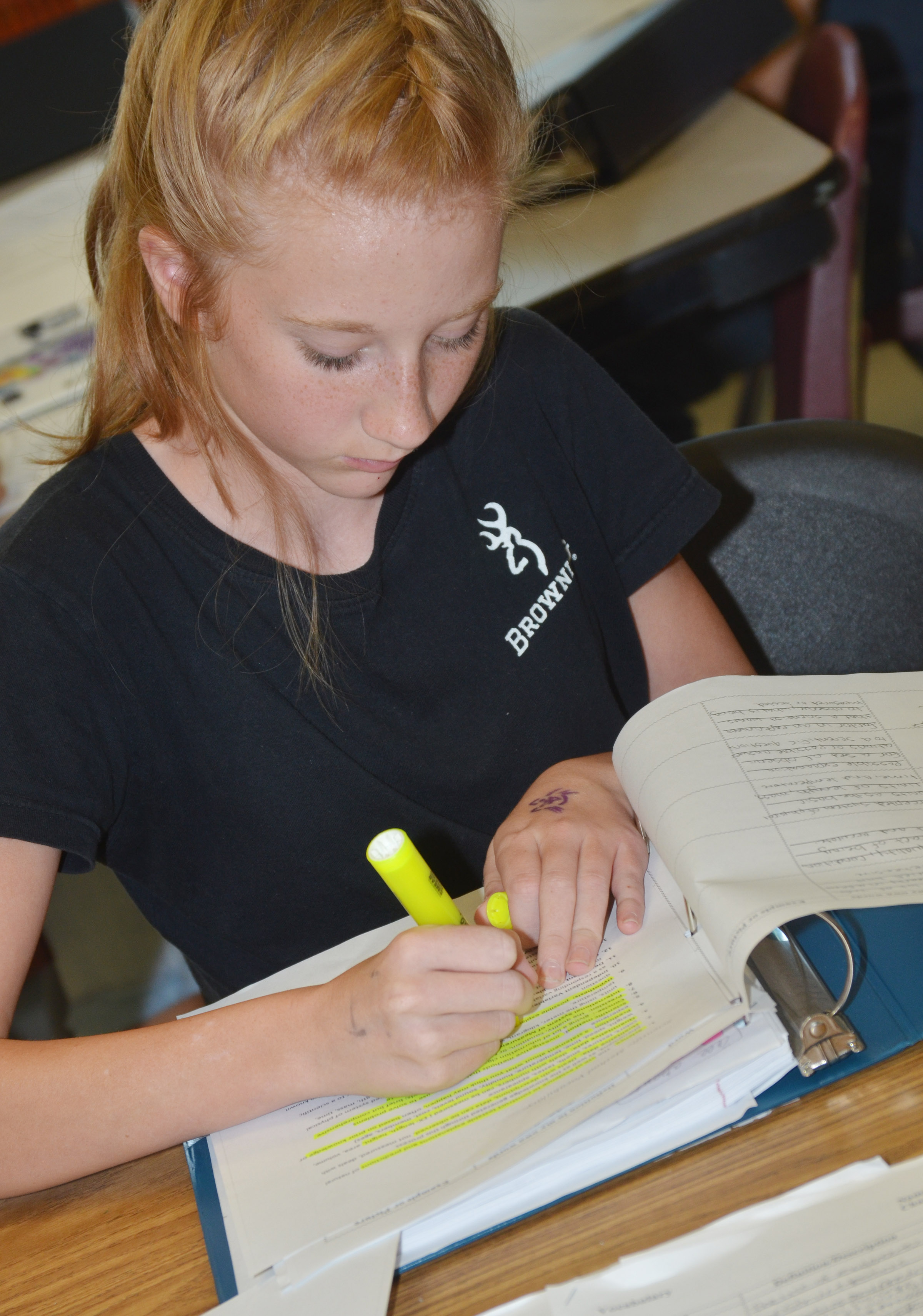 CMS eighth-grader Hayley Wethington highlights her vocabulary worksheet.