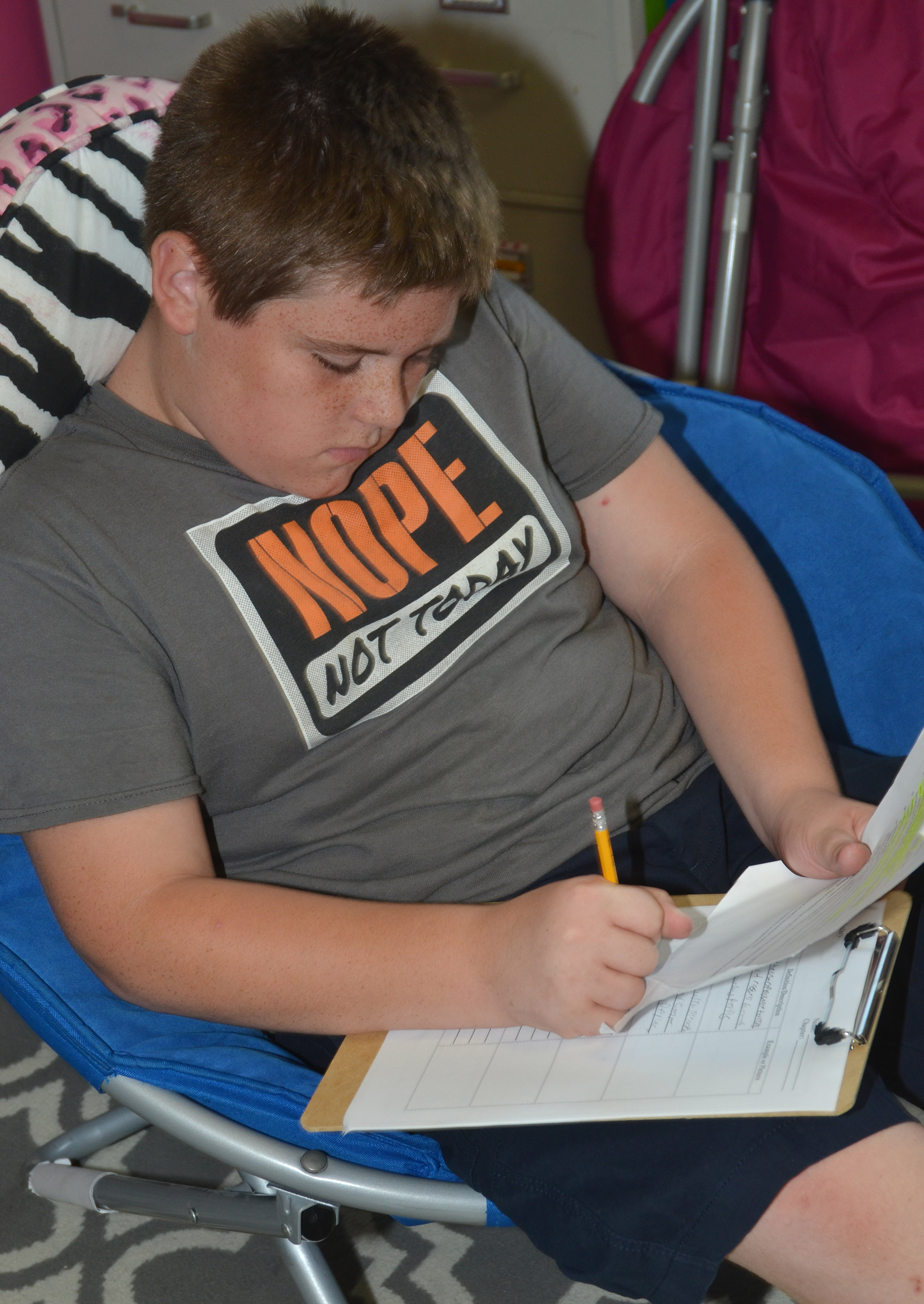 CMS eighth-grader Zachery Underwood writes his definitions.