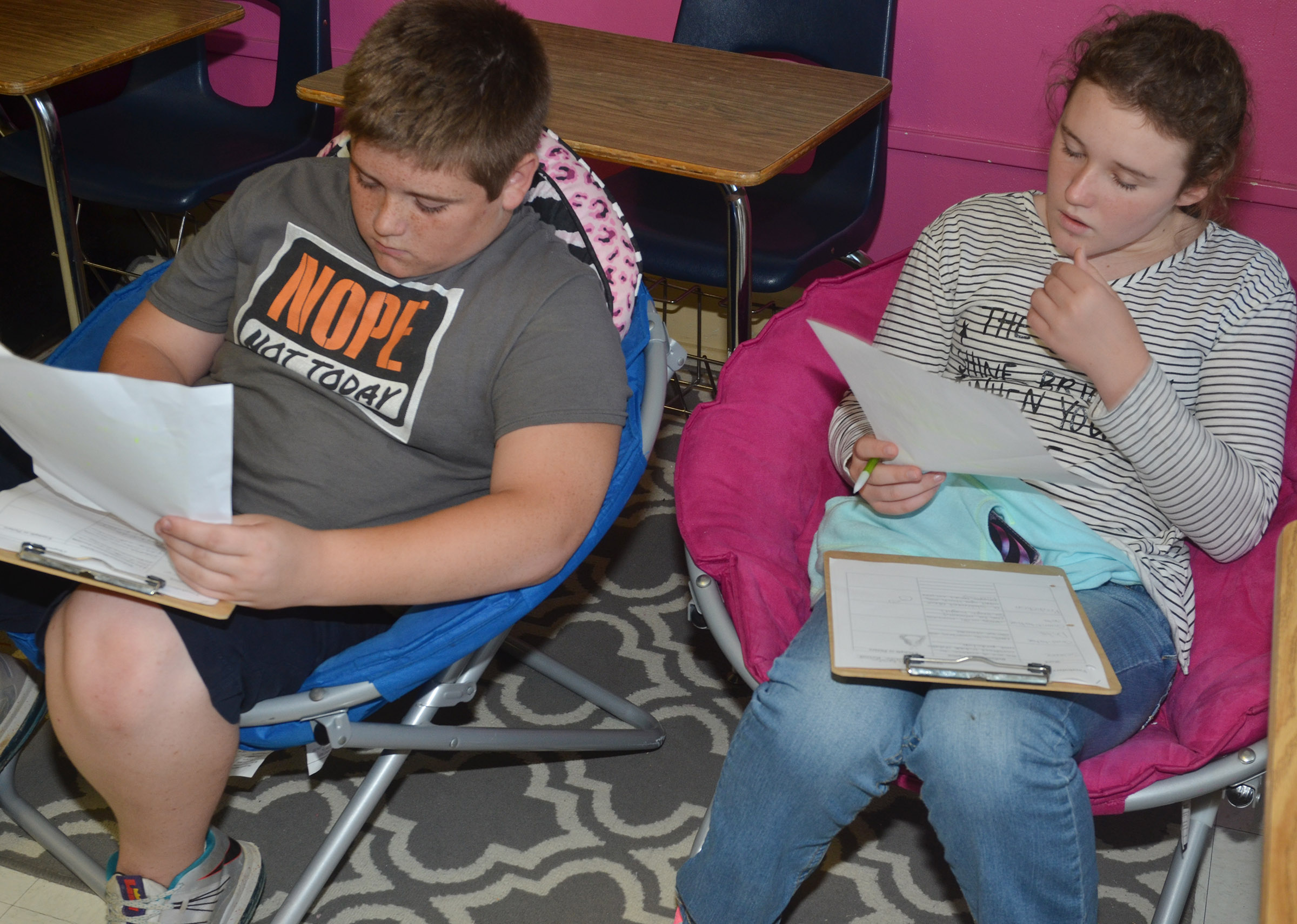 CMS eighth-graders Kaine Terry, at left, and Abby Brisko write their definitions.