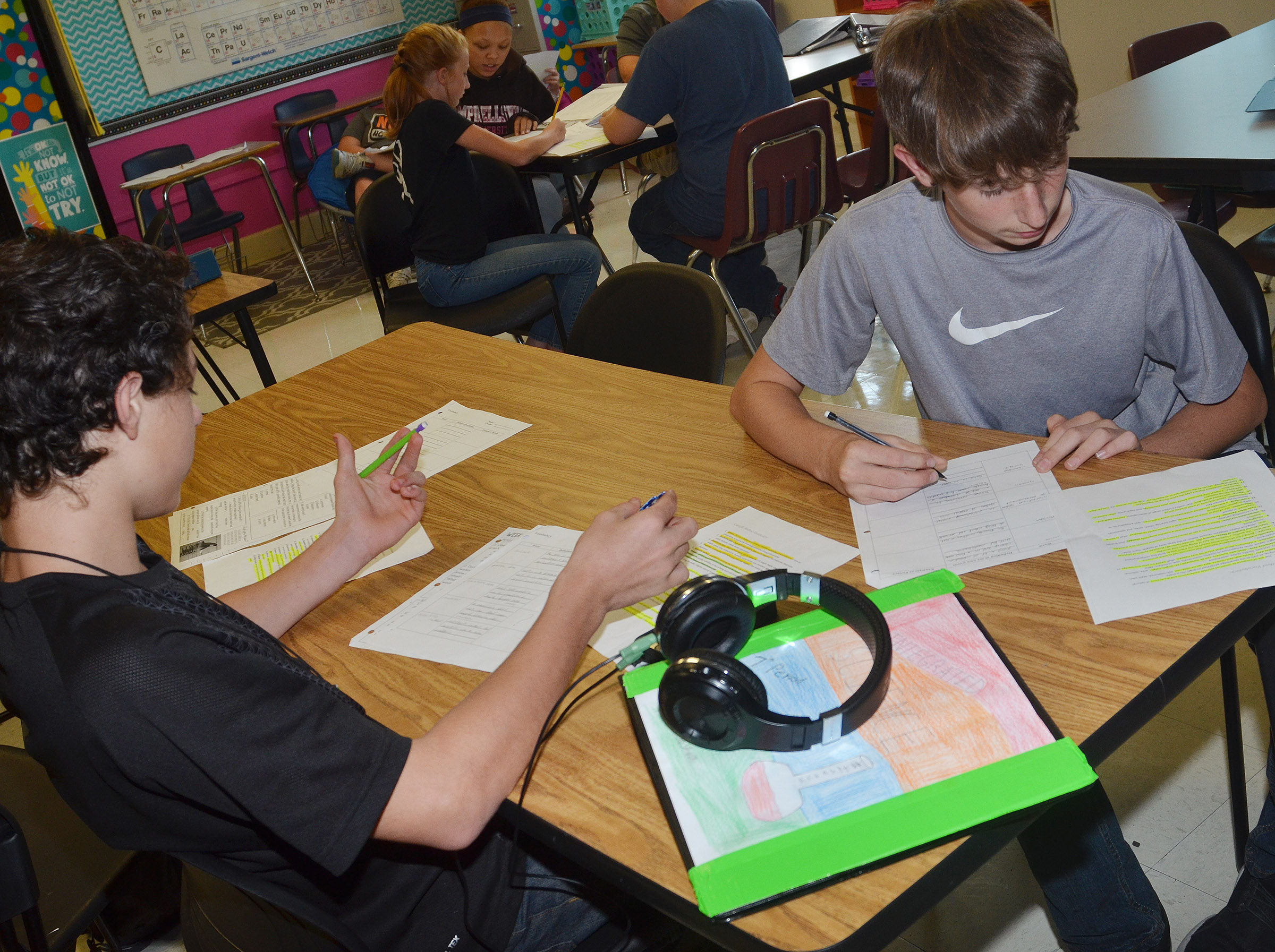 CMS eighth-graders C.J. Adams, at left, and Waylon Franklin write their definitions.