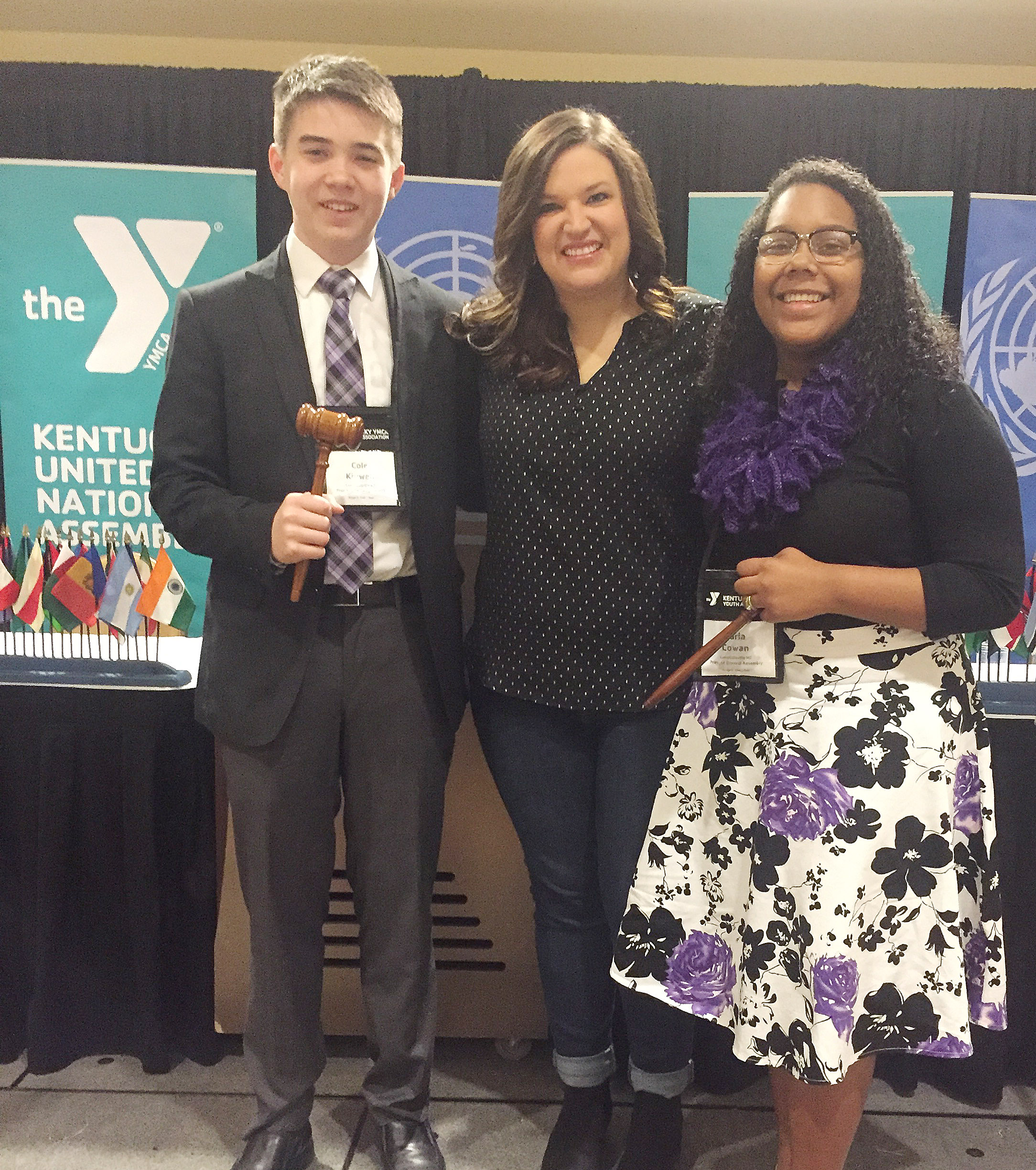 Campbellsville High School freshmen Cole Kidwell, at left, and Zaria Cowan, at right, attended KUNA and served in leadership roles. Cowan was president of the United Nations General Assembly, and Kidwell served as president of the Security Council. CMS eighth-grader teacher Robbilyn Speer sponsors the CMS Y-Club.