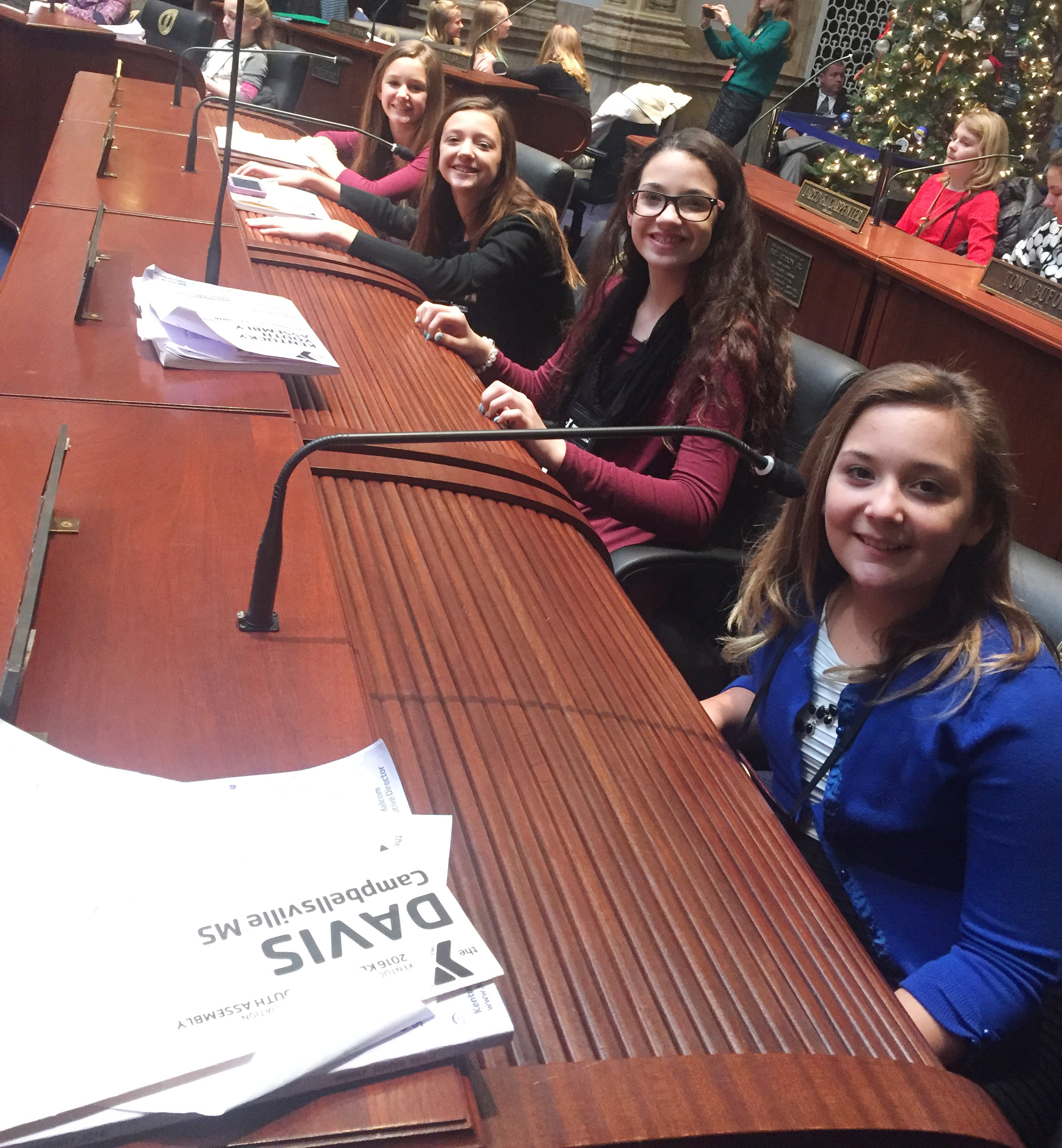 From left, CMS sixth-graders Haylee Allen, Bri Hayes, Mary Russell and Briana Davis sit on the Senate floor.