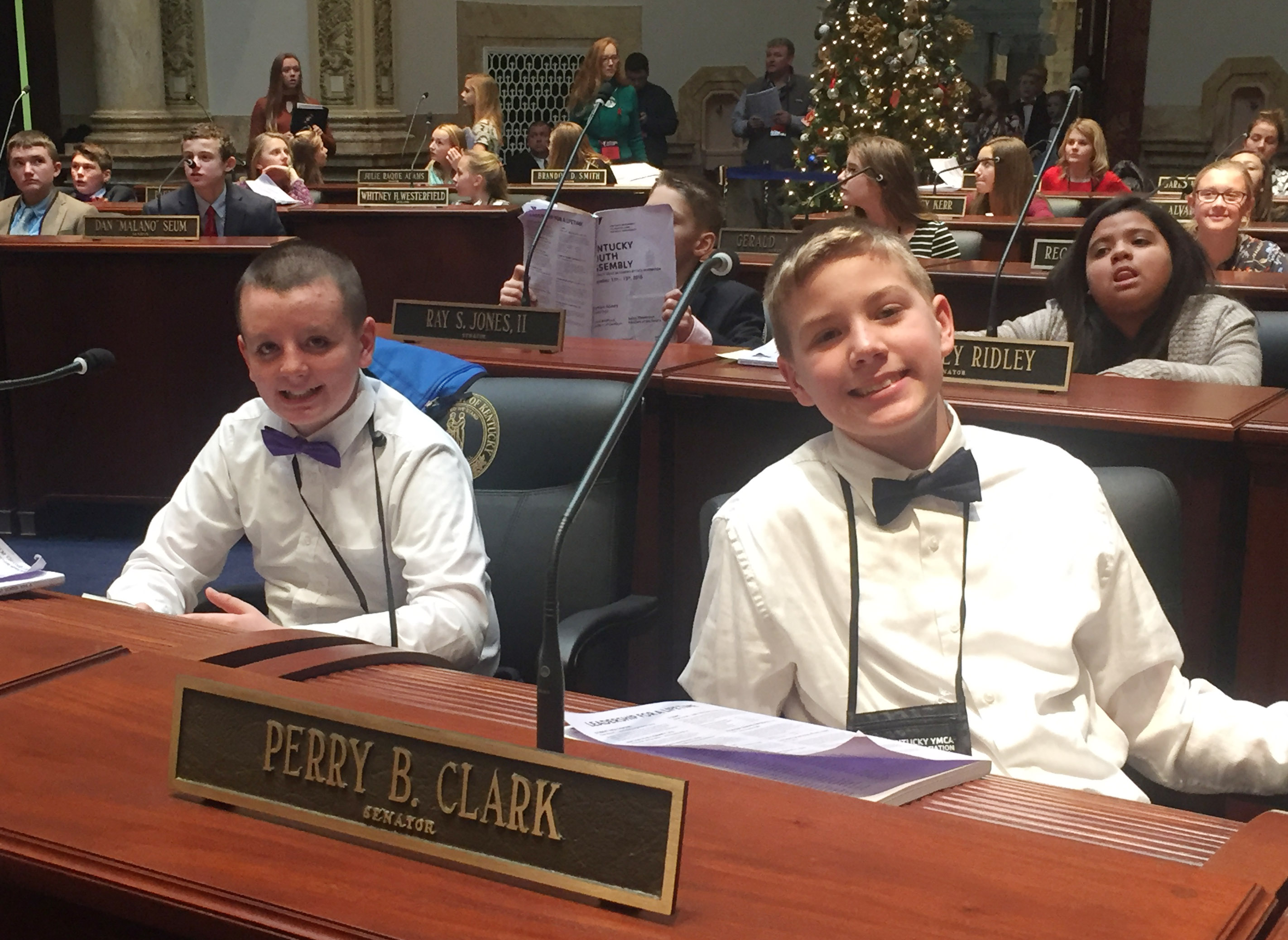 CMS sixth-graders Jacob Judd, at left, and Wesley Reynolds sit on the Senate floor.