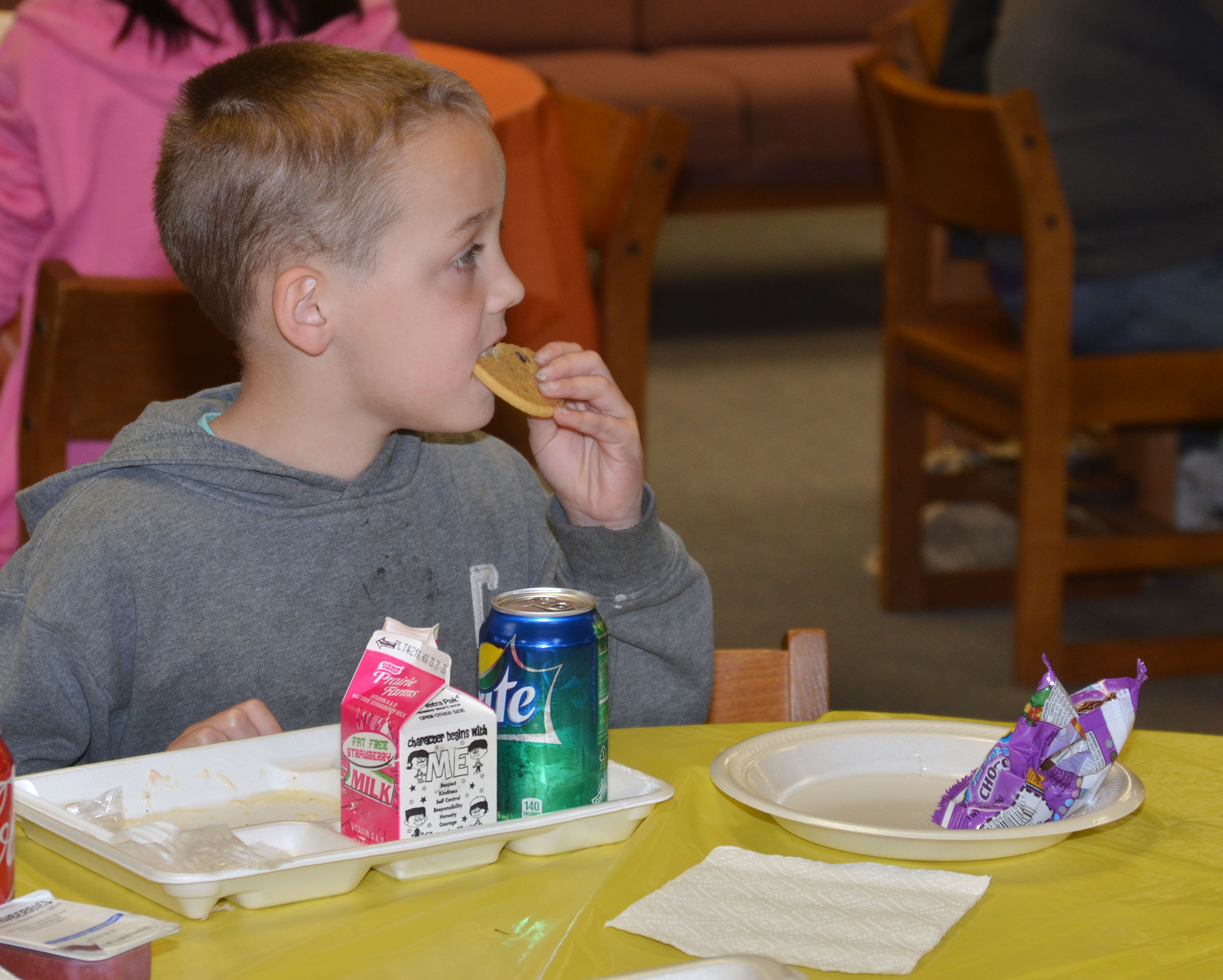 CMS fourth-grader Spencer Bates enjoys a cookie.
