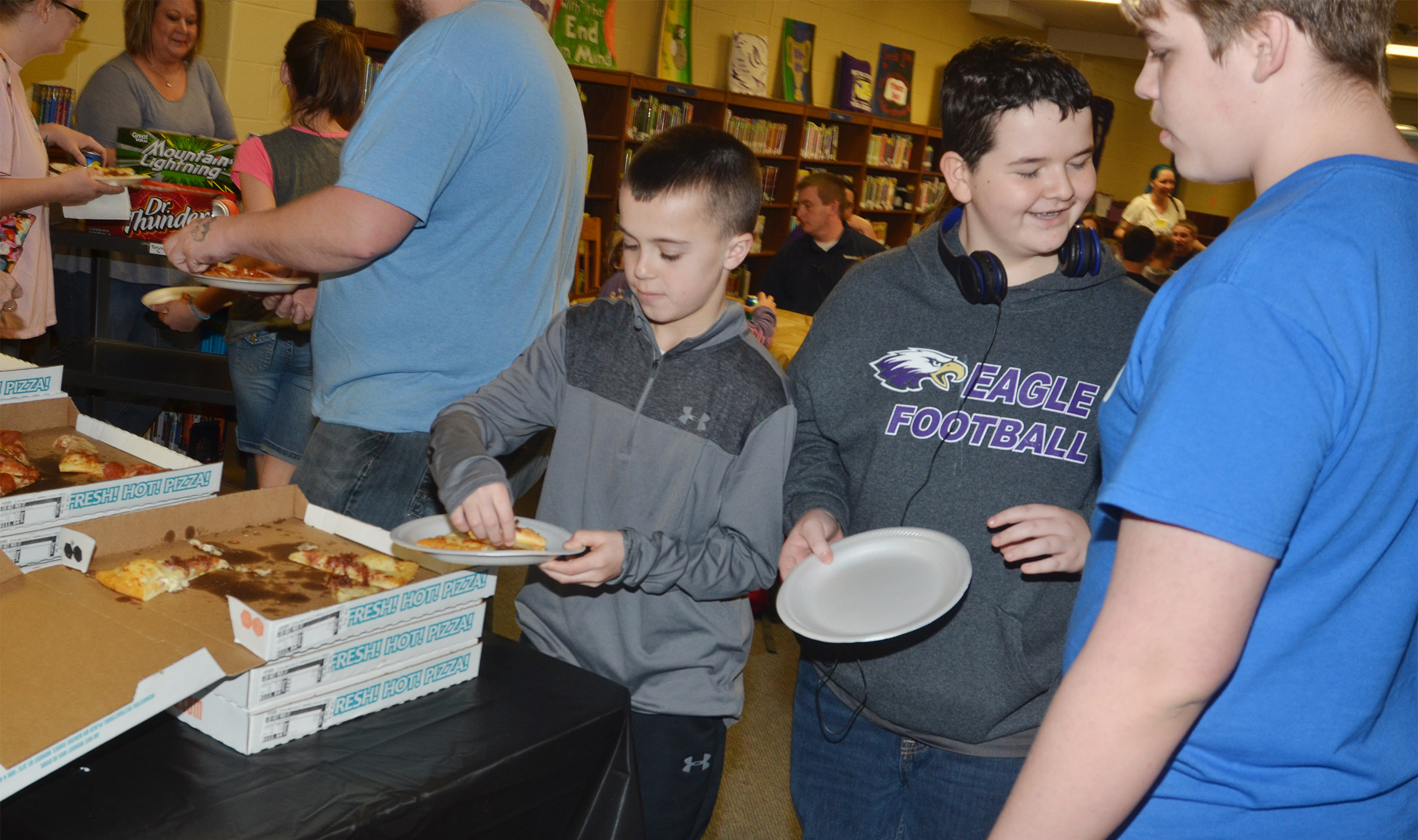 From left, CMS sixth-grader Chase Hord and seventh-graders Adin Hunt and Austin Jeffries are treated to a pizza lunch.