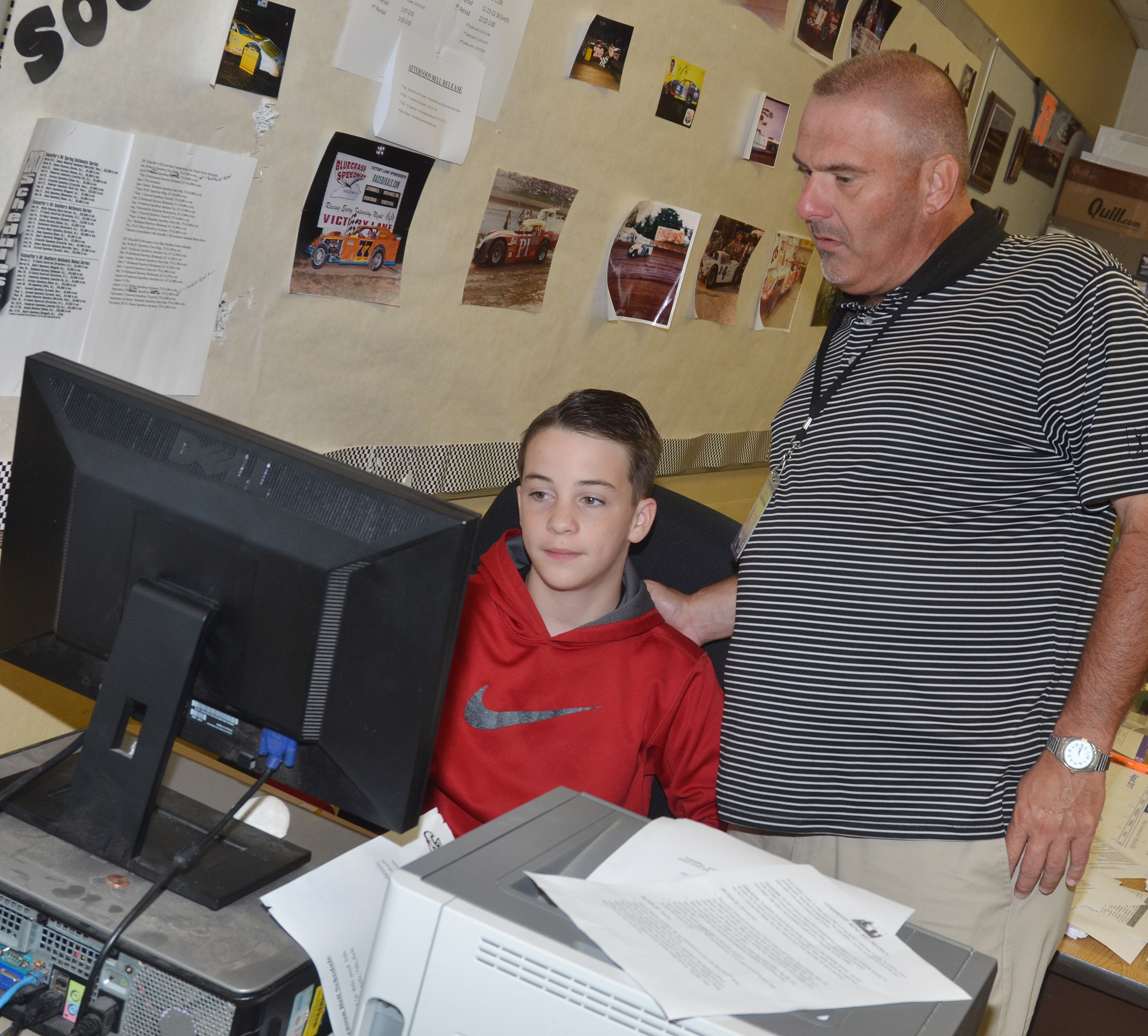 CMS teacher Michael Despain helps seventh-grader Sean Mings with his autobiographical assignment.