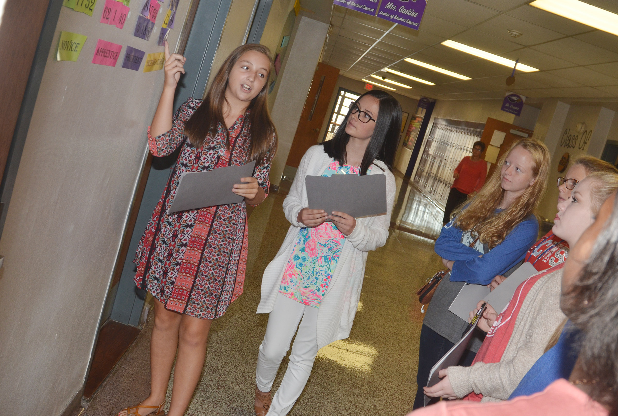 CMS eighth-graders Lainey Watson, at left, and Sarah Adkins give their Casey County Middle School guests a tour of their school.