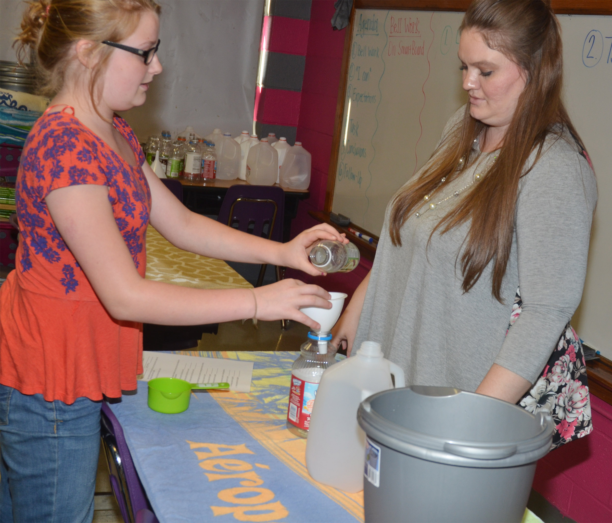 CMS fifth-grader Summer Jacobs practices converting liquid measurements with teacher Ann Michael Tucker.