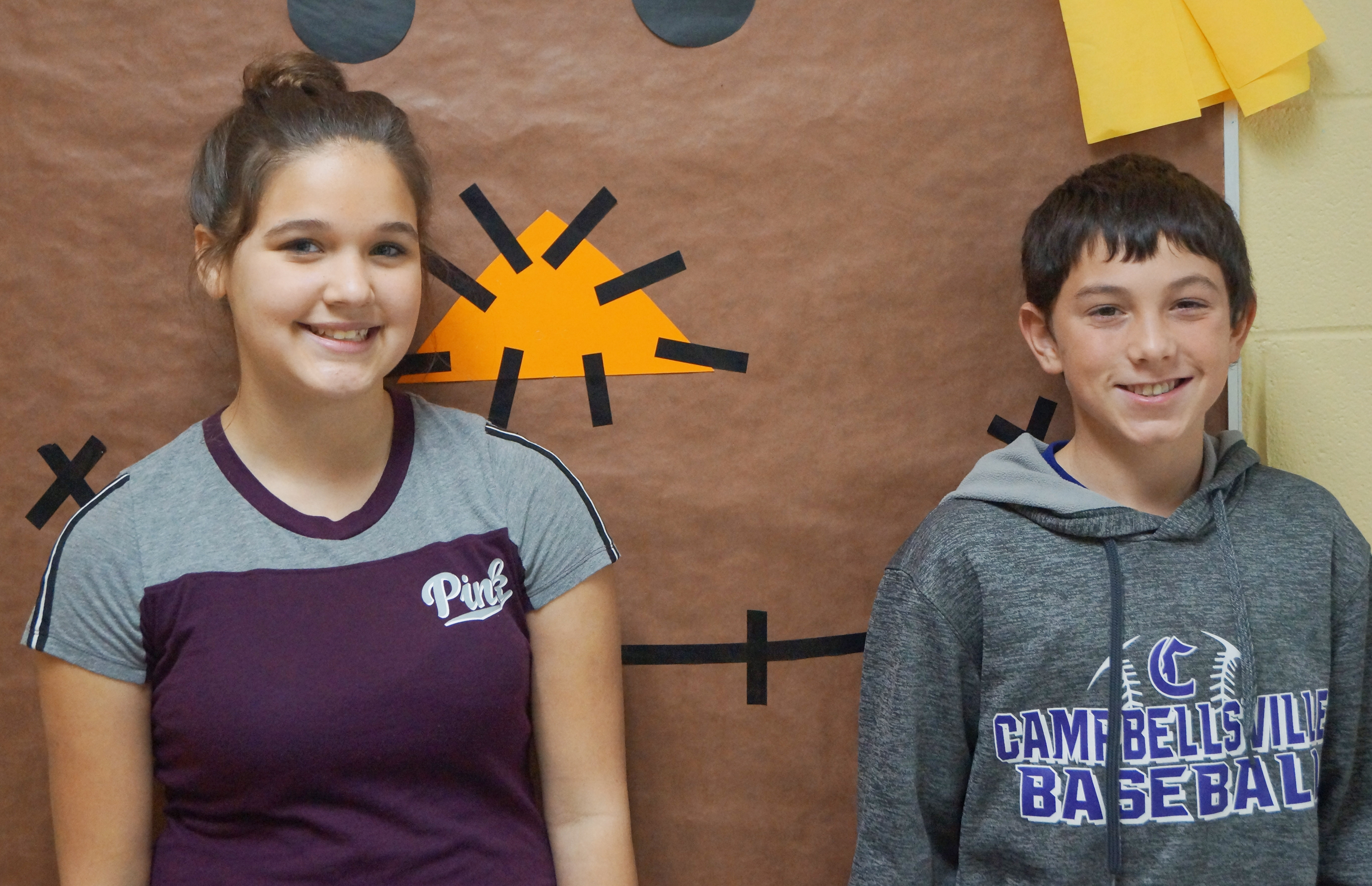 From left are seventh-grader Kailey Lozano and eighth-grader Dakota Harris. Absent from the photo is sixth-grader Tucker Cartwright.