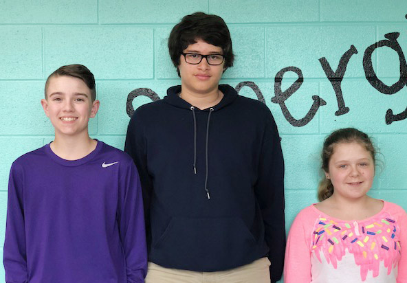 From left are seventh-grader Bryce Newton, eighth-grader Nate Arachi and sixth-grader Alexis Sharp.