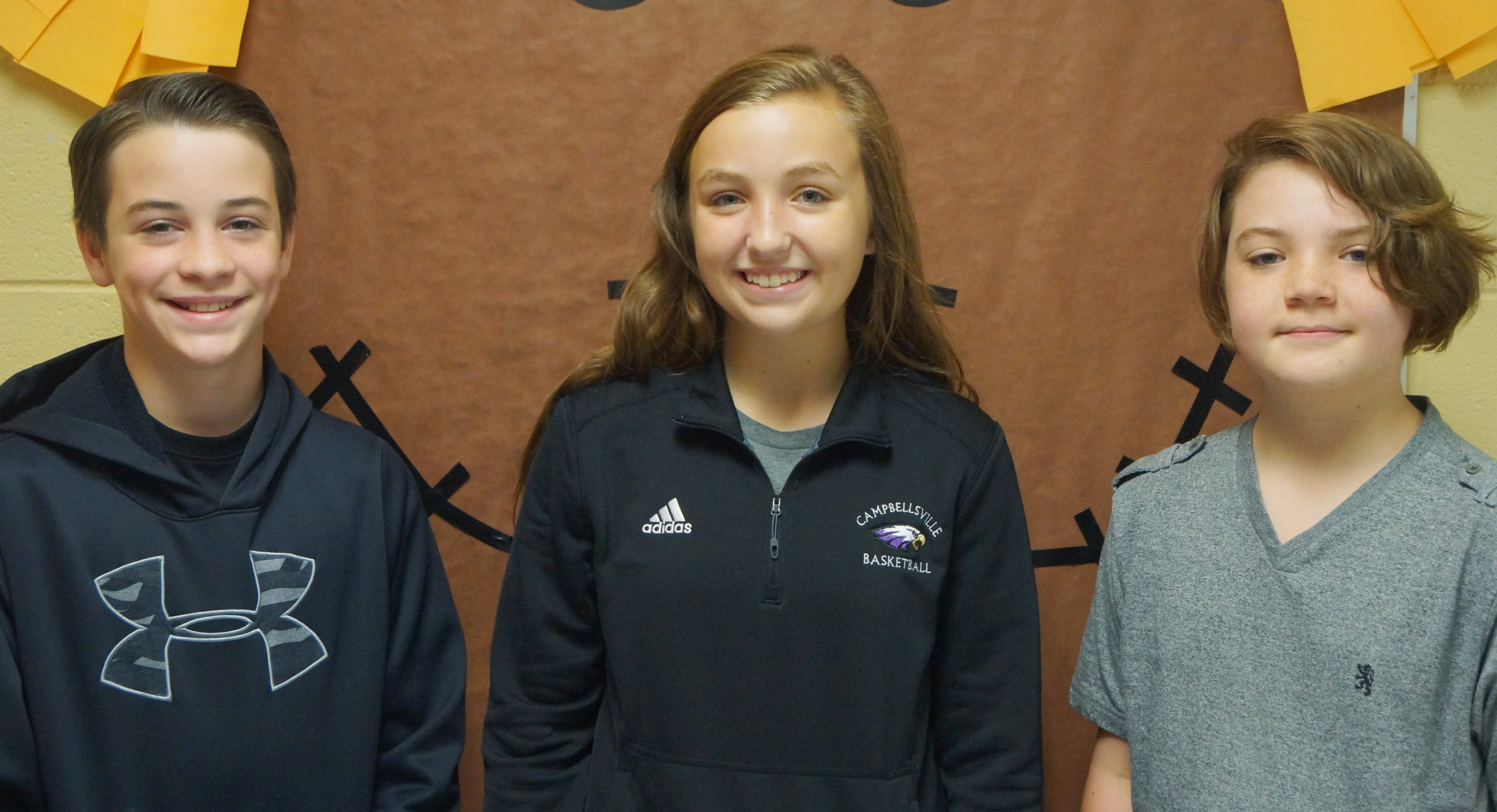 From left are seventh-grader Sean Mings, eighth-grader Lainey Watson and sixth-grader Kayden Birdwell.