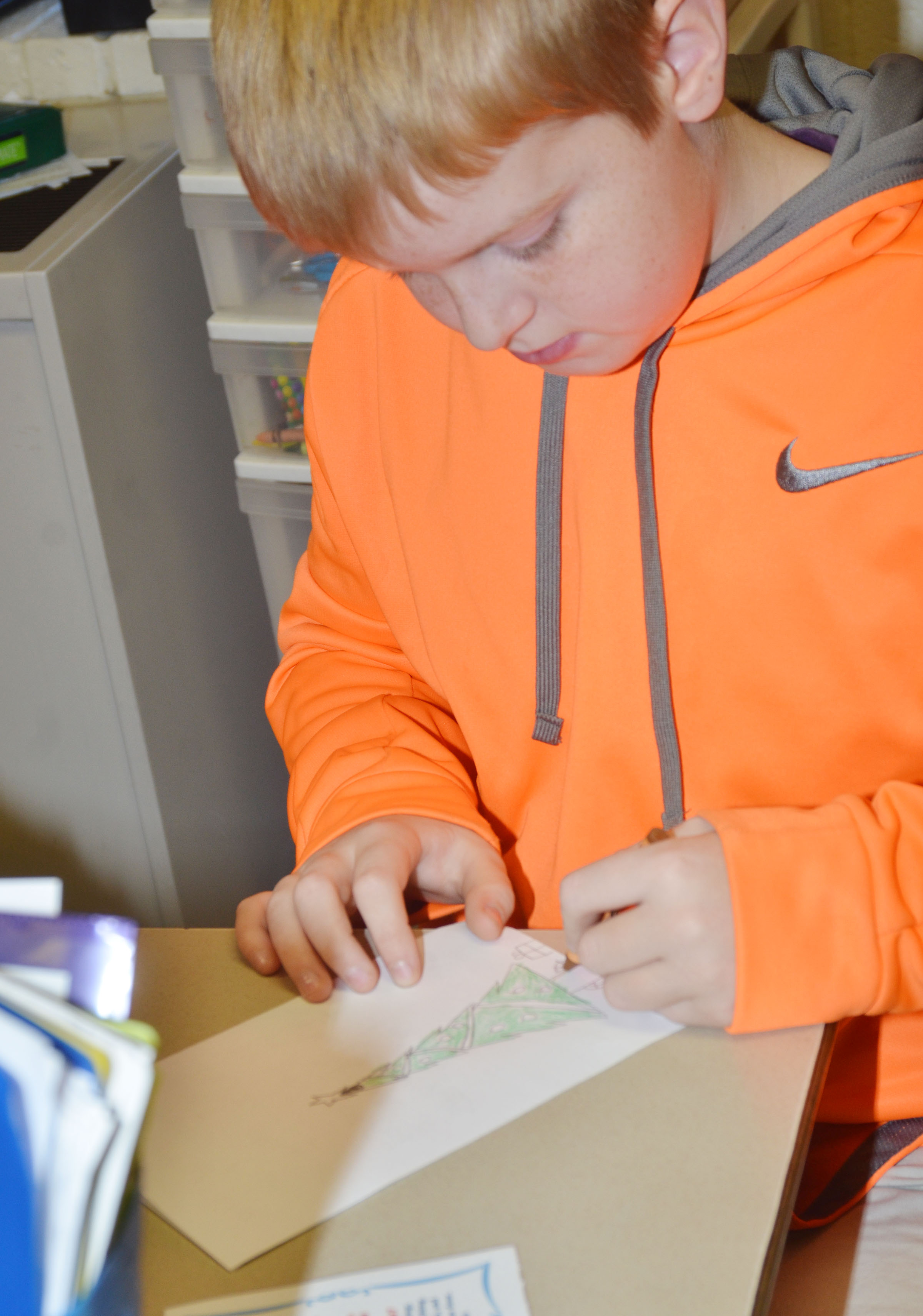 CMS fifth-grader Ryder Cundiff colors a card he made for a soldier.