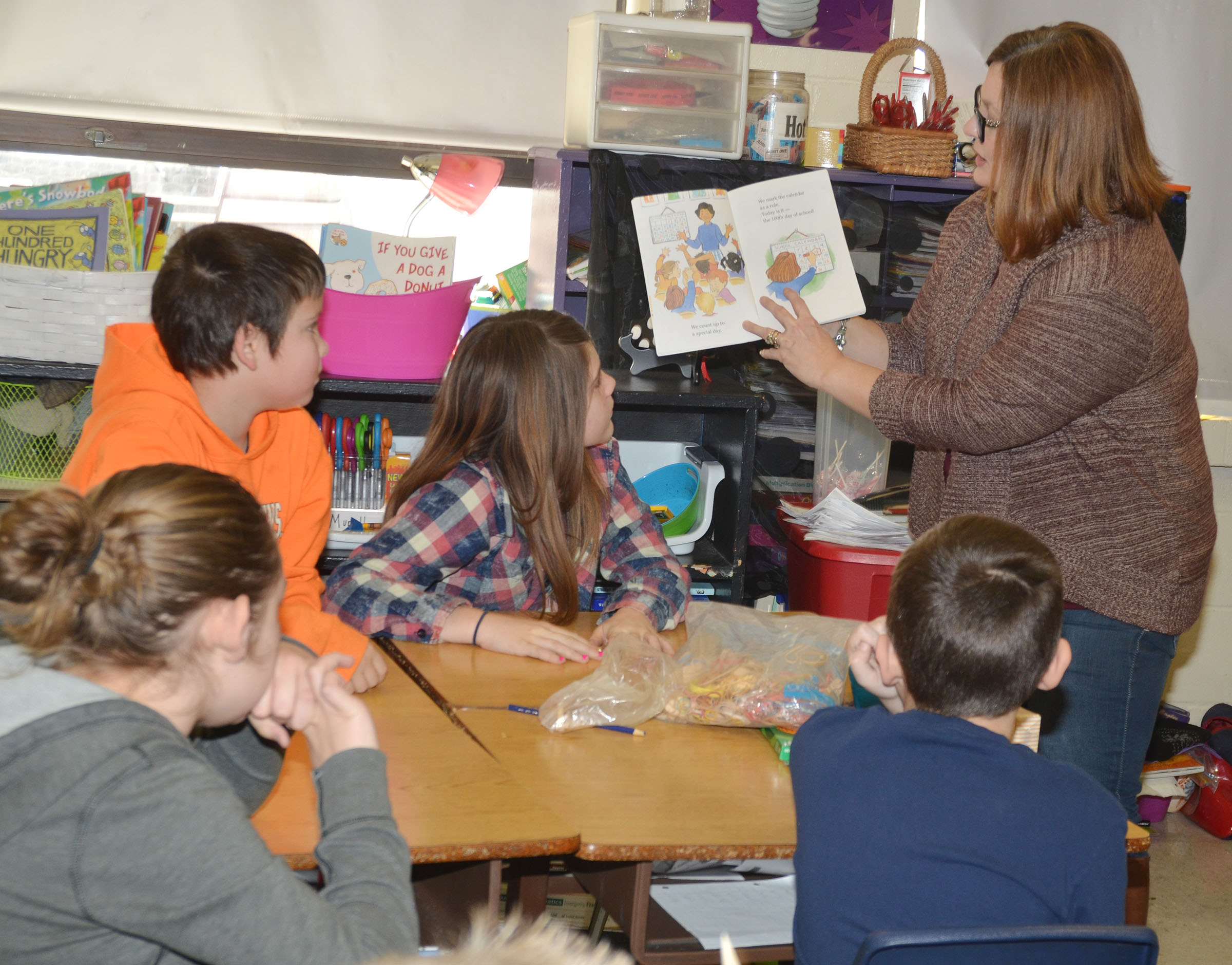 "CMS fourth-grade teacher Garnetta Murrell reads ""The 100th Day of School"" to her students."
