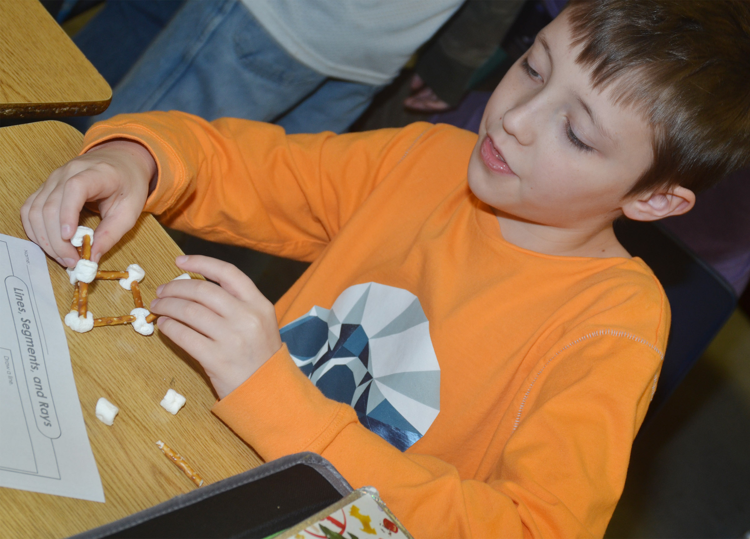 CMS fourth-grader Jaxon Garrett makes a geometric shape with marshmallows and pretzels.