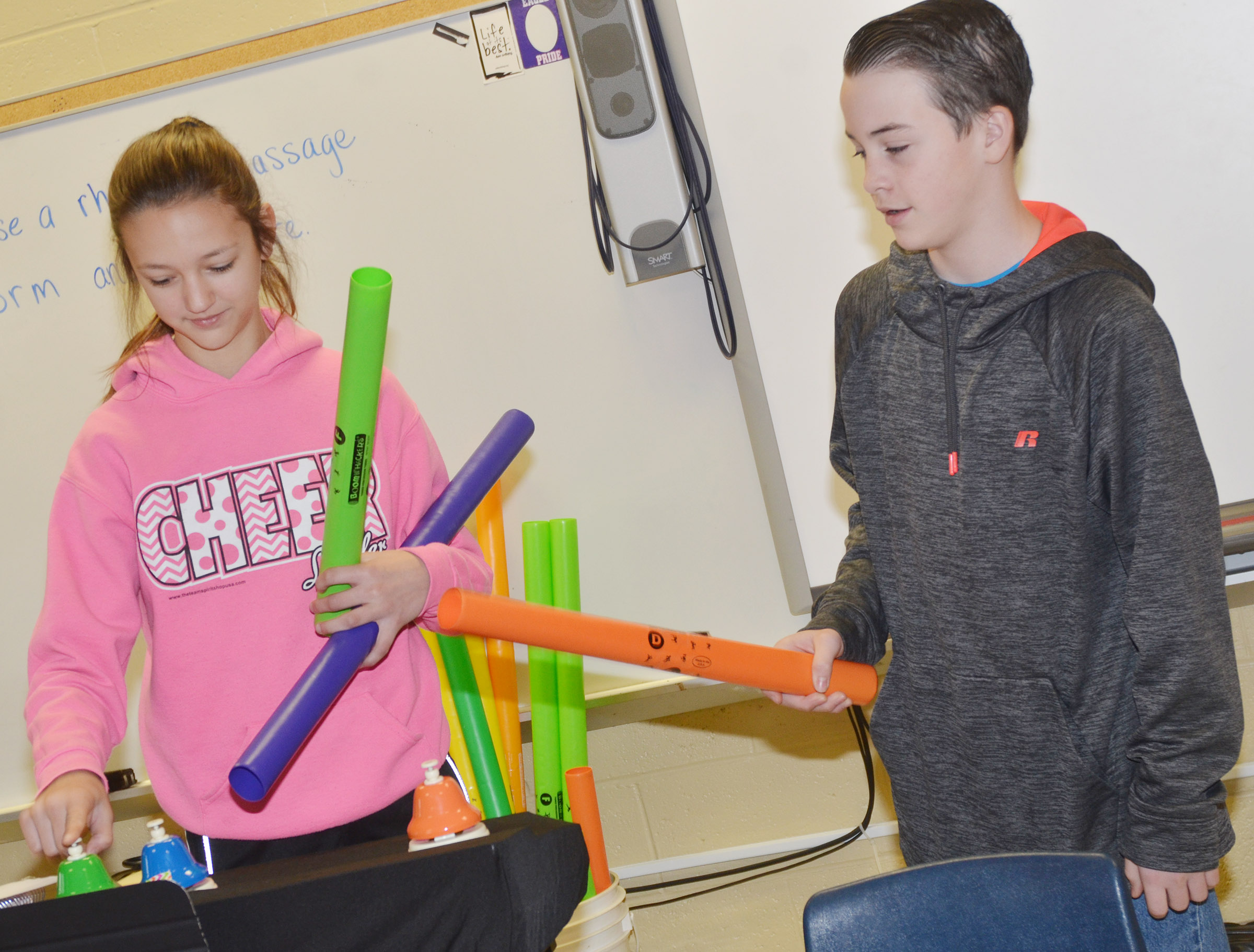 CMS seventh-graders Bri Hayes, at left, and Sean Mings play their original song on the bells and boomwhackers.