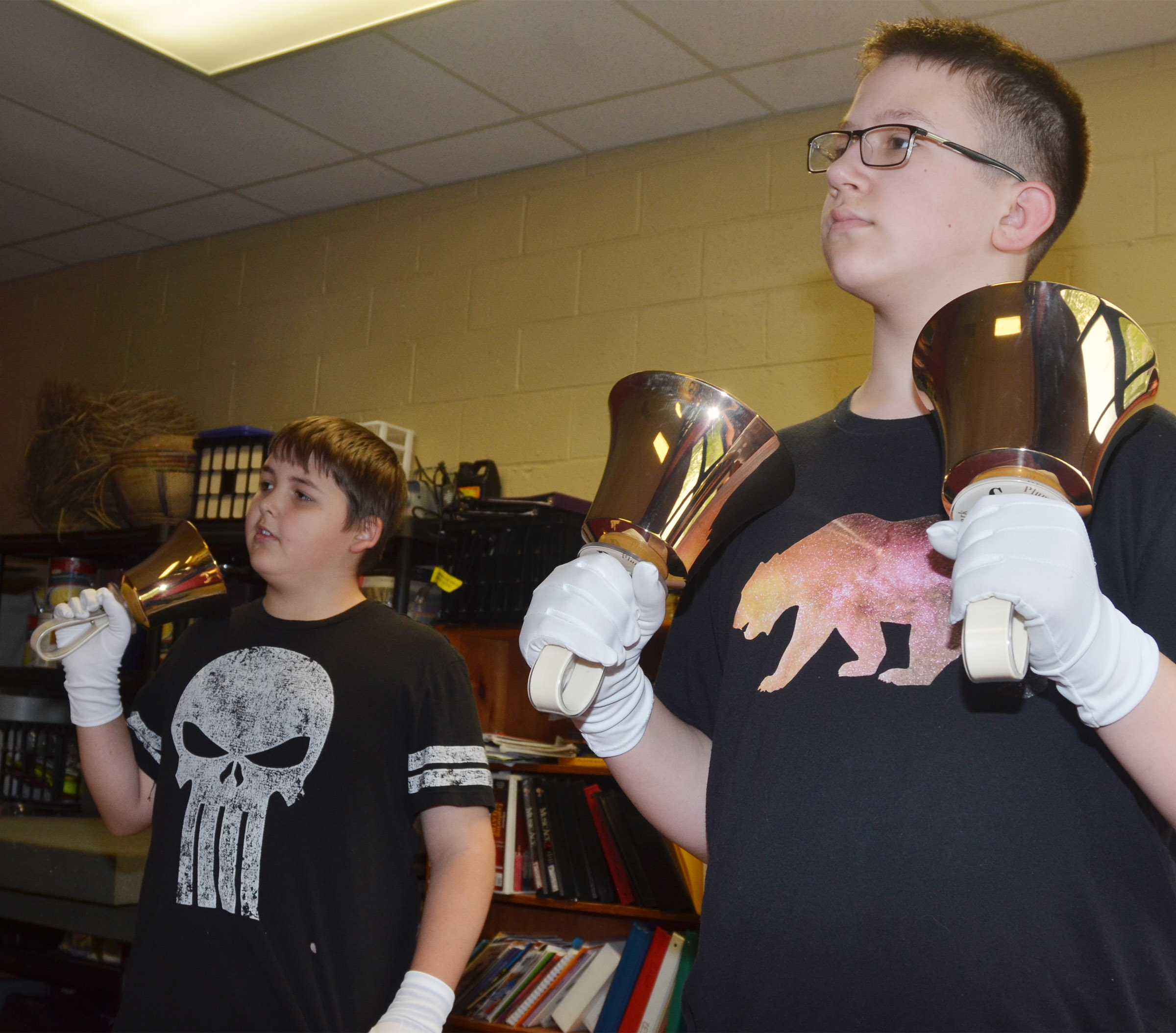 CMS seventh-grader Kaine Terry, at left, and eighth-grader Nathan Sowders play the handbells.