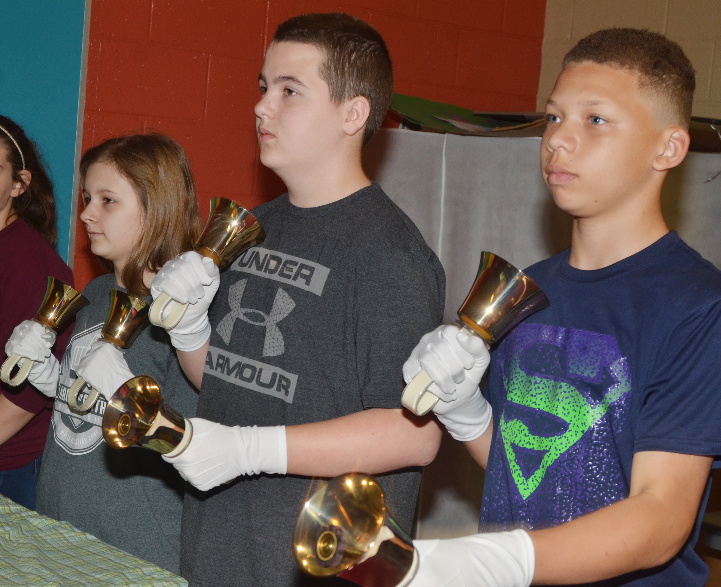 From left, CMS seventh-graders Serenity Ford, Jack Sabo and Dalvian Thornton play the handbells.