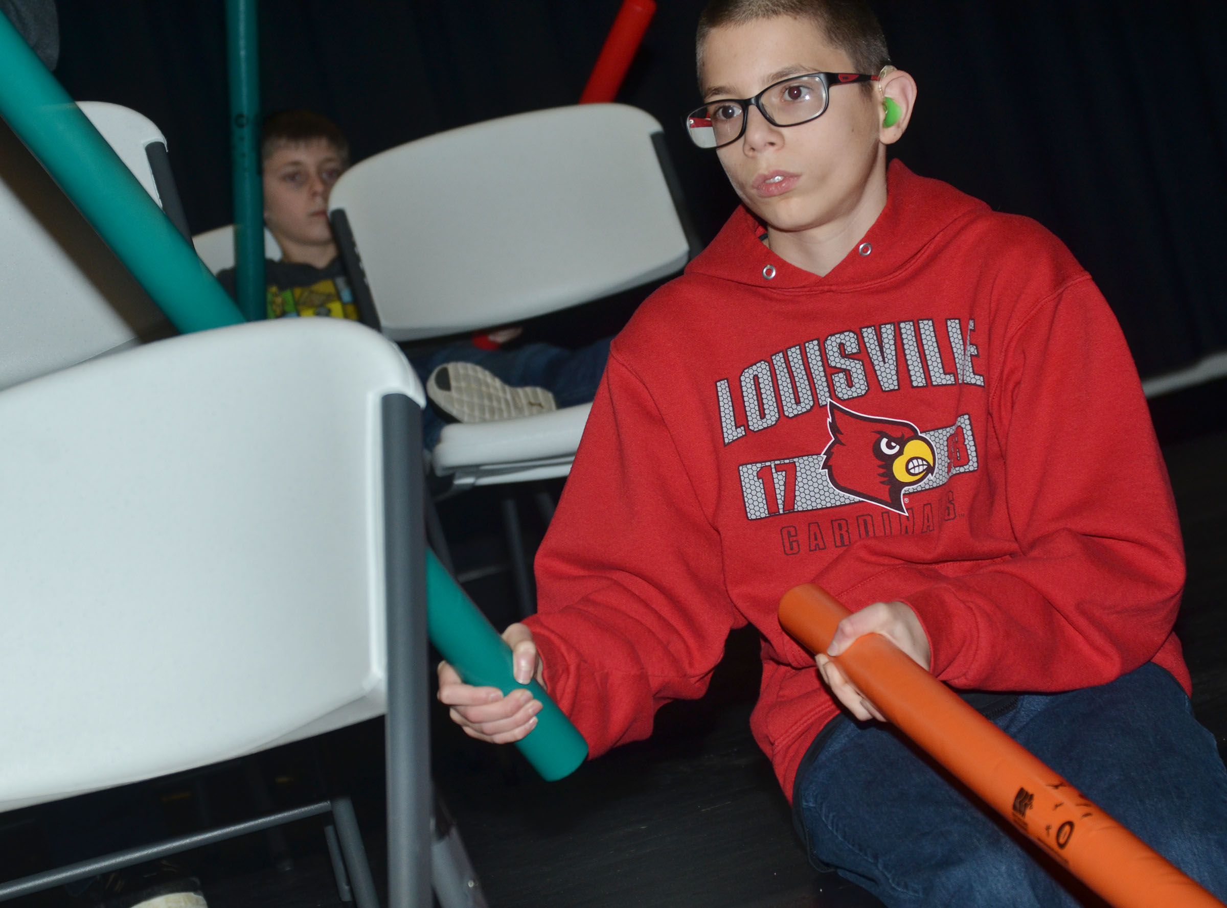 "CMS seventh-grader Grant Lawson plays ""Radioactive"" with boom whackers."