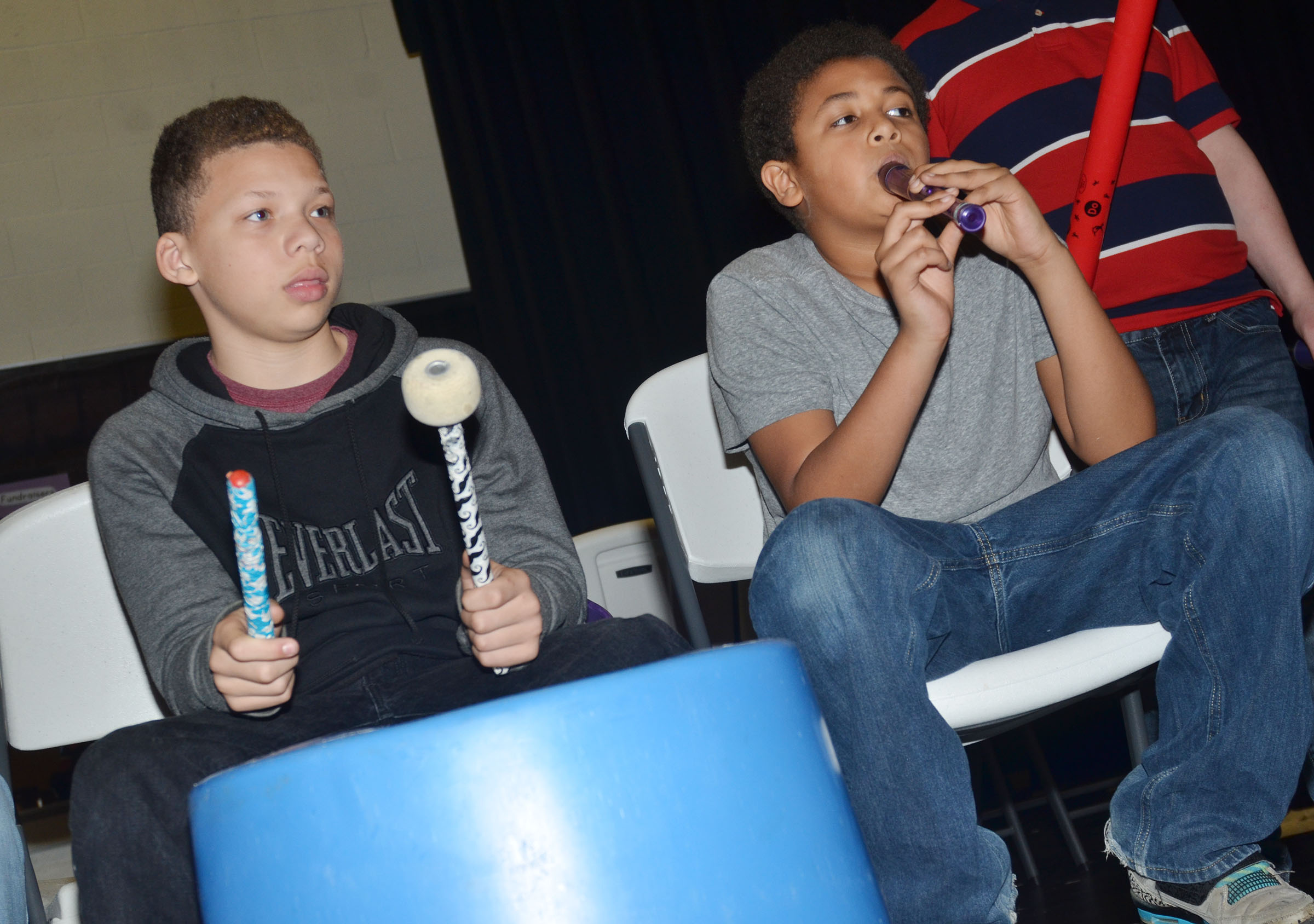 "CMS seventh-grader Dalvian Thornton, at left, and sixth-grader Ronin Smith play ""Radioactive"" on the drums and recorder."