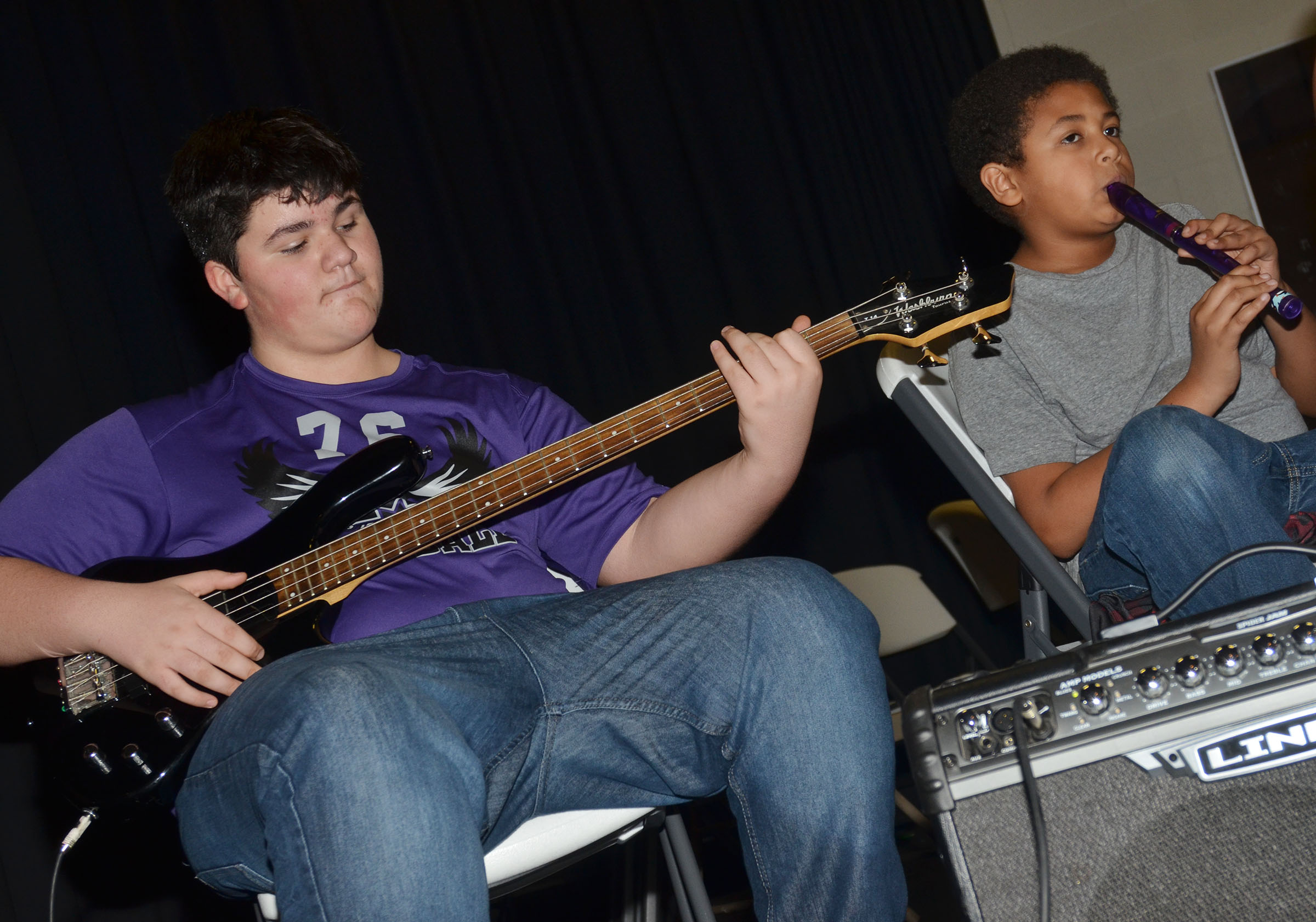 "CMS seventh-grader Logan Rakes, at left, and sixth-grader Ronin Smith play ""Radioactive"" on the guitar and recorder."