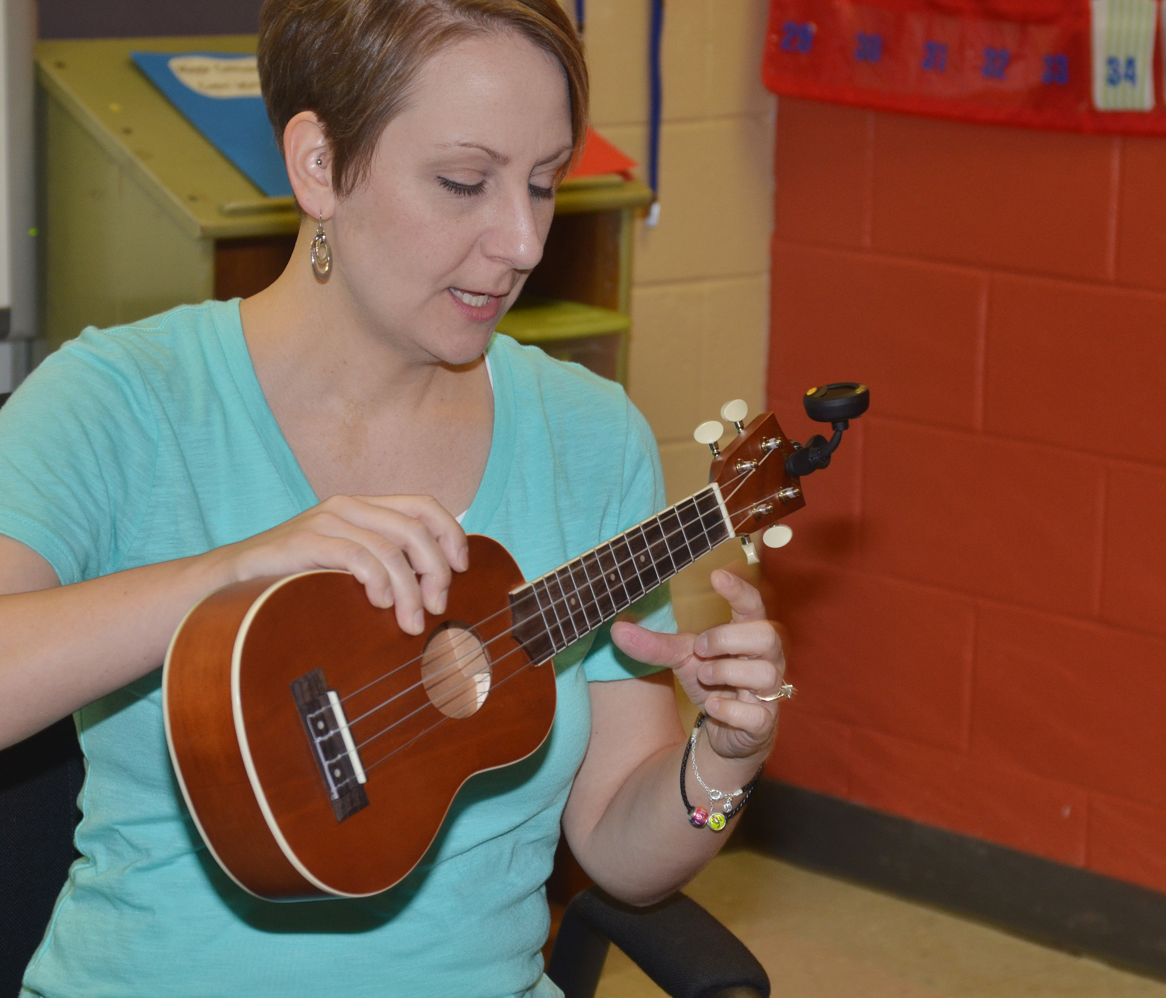 CMS music teacher Jessica Floyd shows her students how to hold the ukulele.