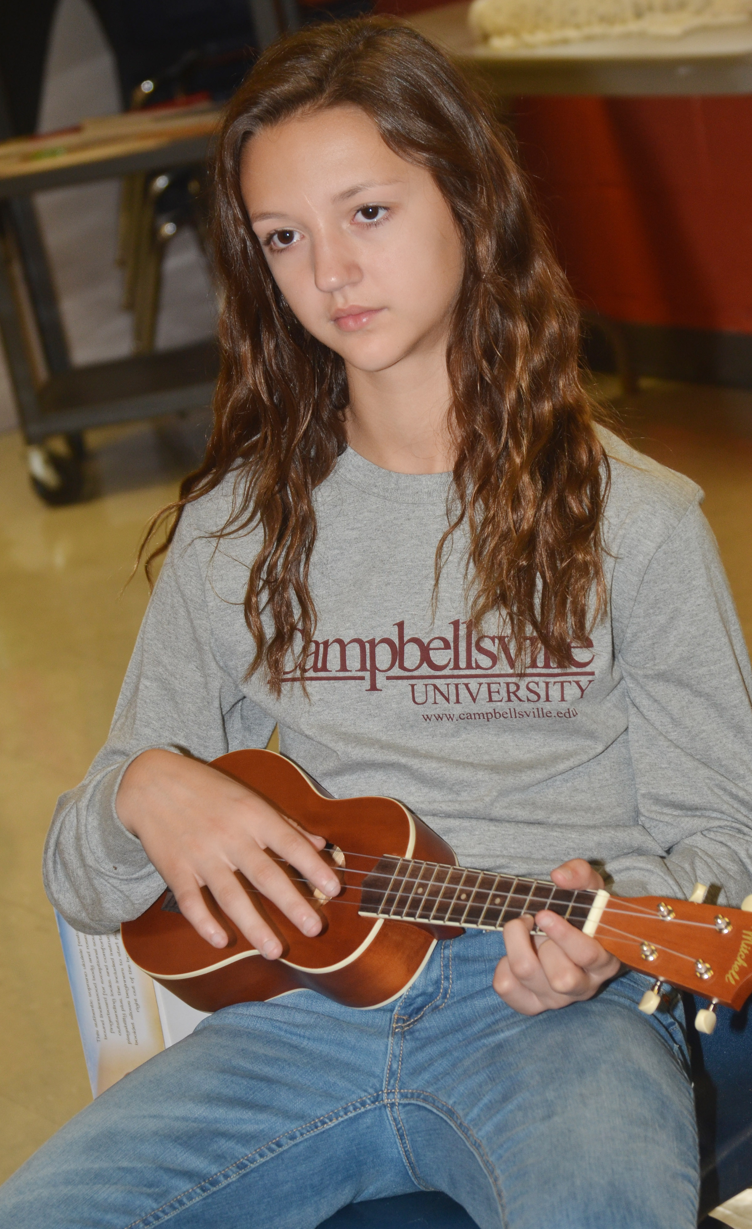 CMS seventh-grader Bri Hayes plays a chord.