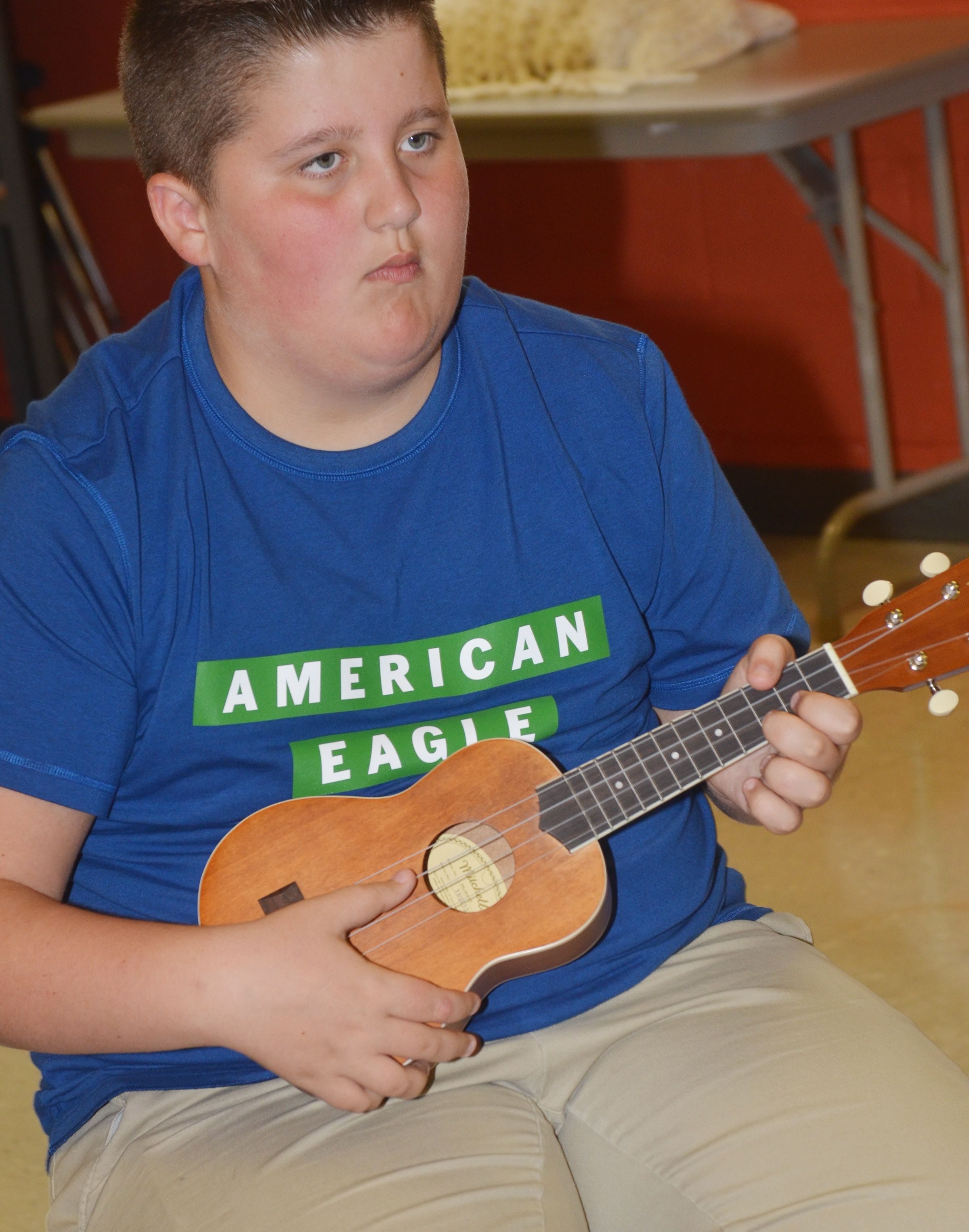CMS sixth-grader Luke McDonald plays a chord.