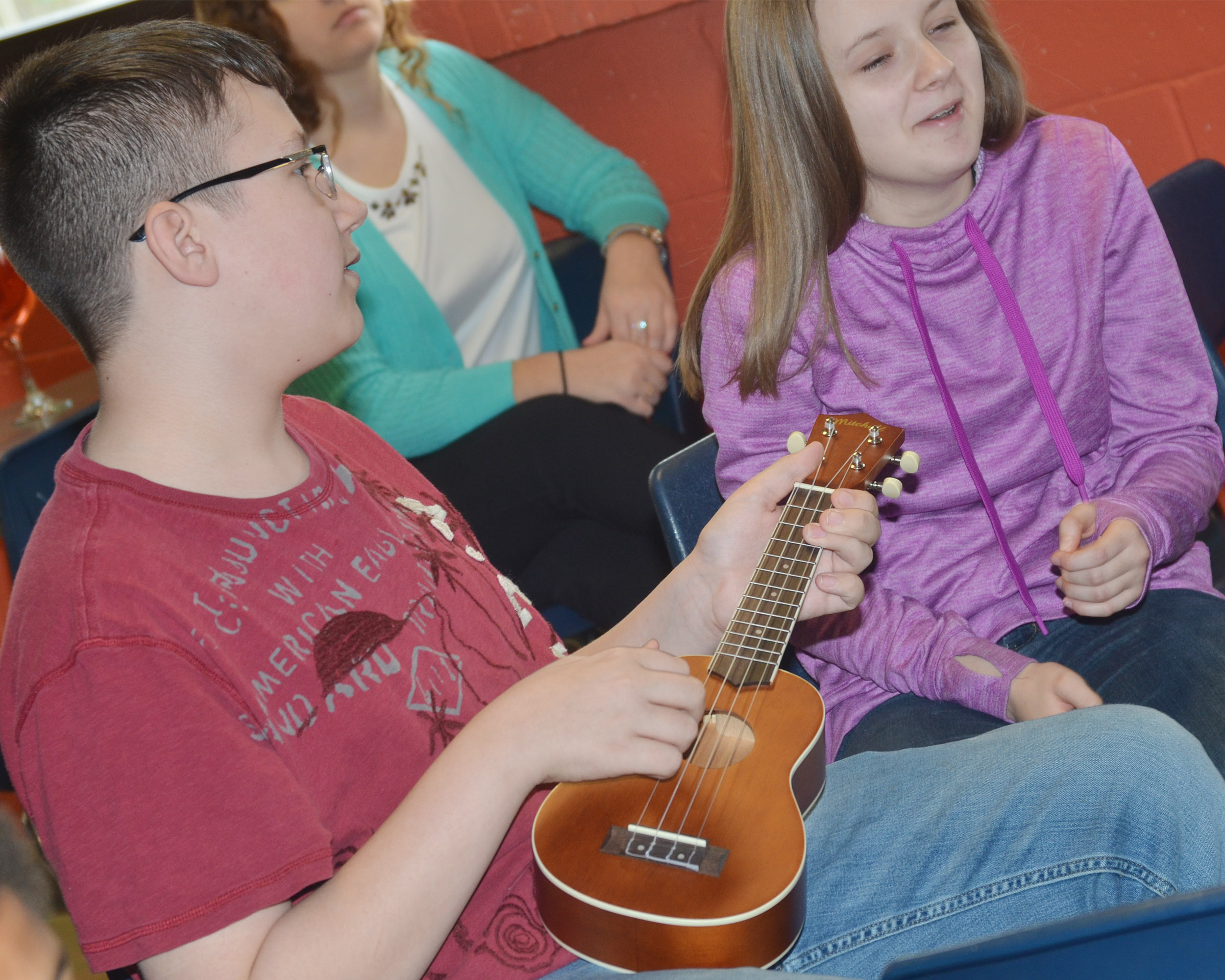CMS eighth-grader Nathan Sowders plays a chord on the ukulele.
