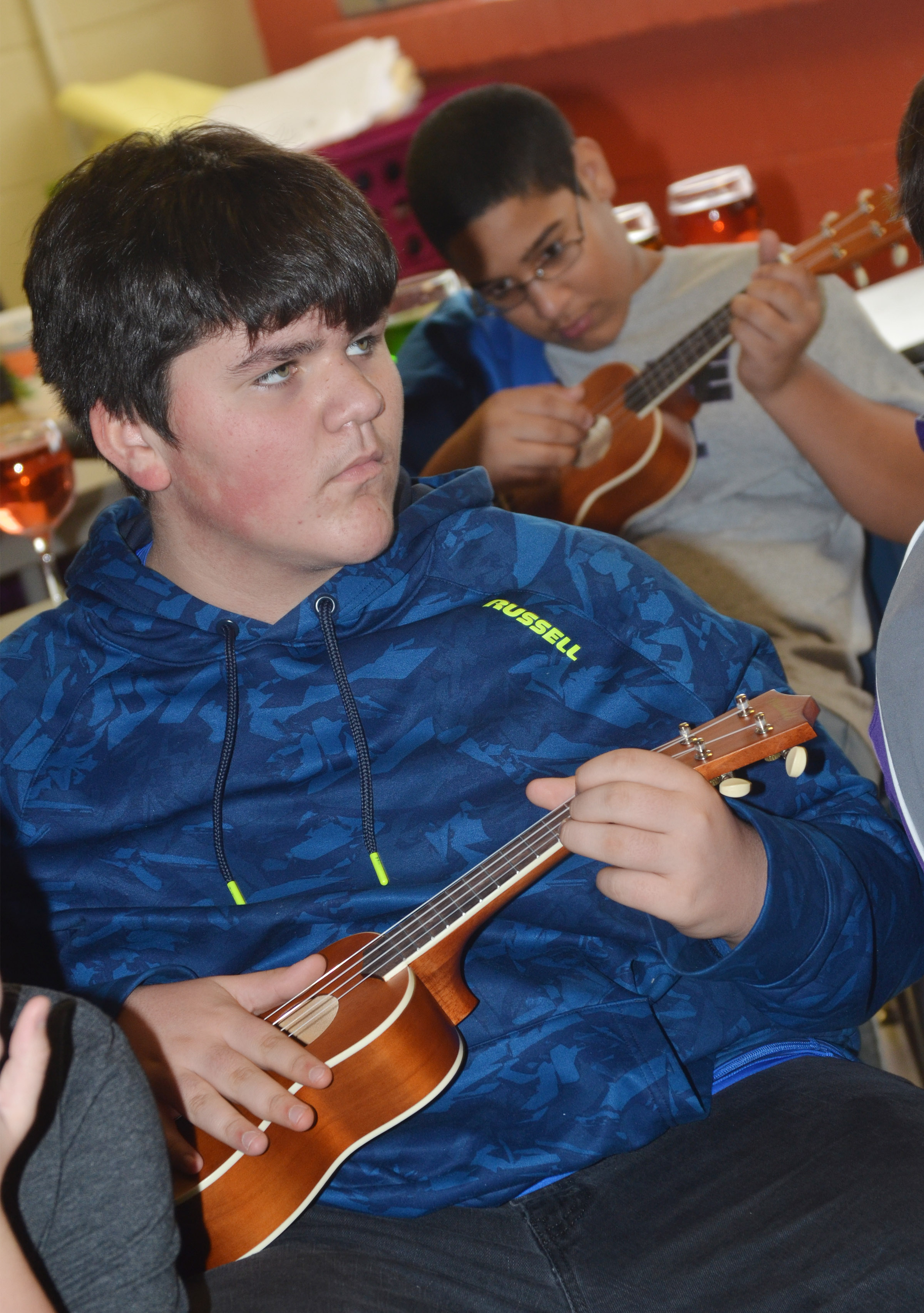 CMS seventh-grader Logan Rakes plays a chord on the ukulele.