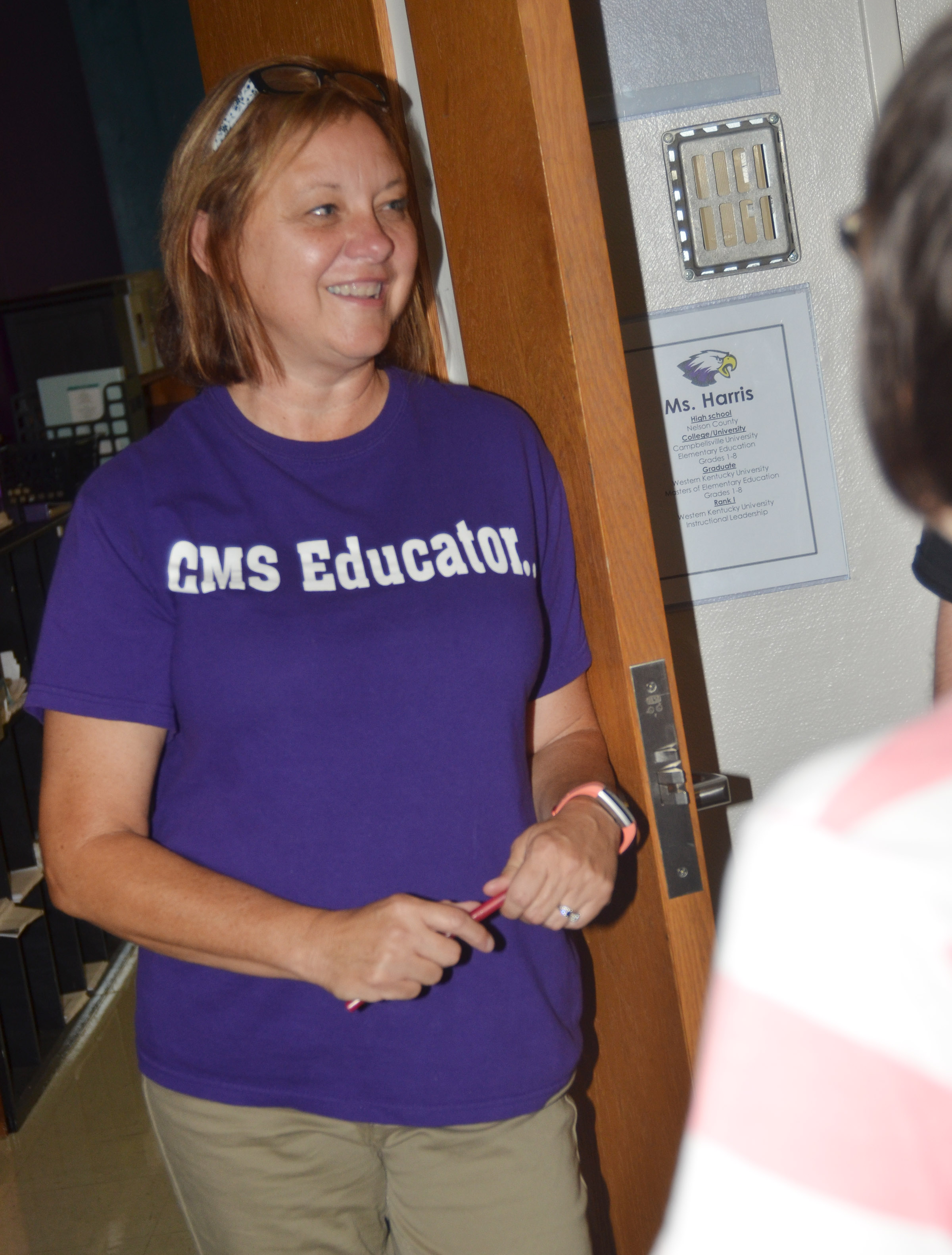 CMS teacher Sharon Harris talks with a parent.