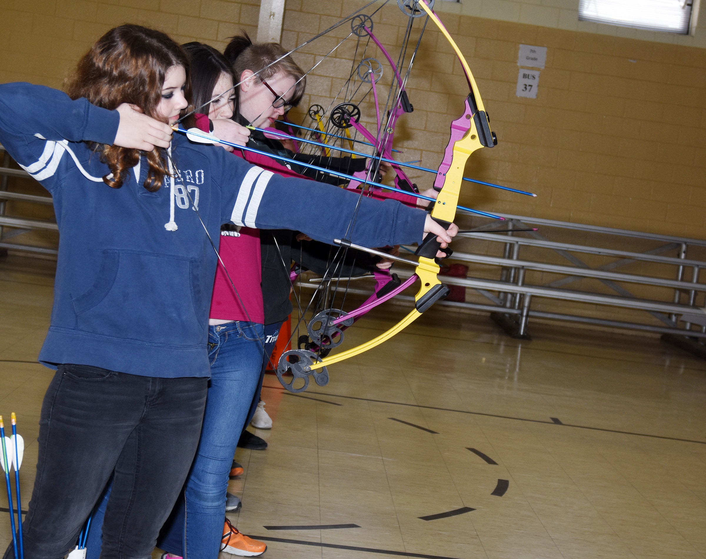 CMS eighth-grader Leah Parker and her classmates shoot their arrows.