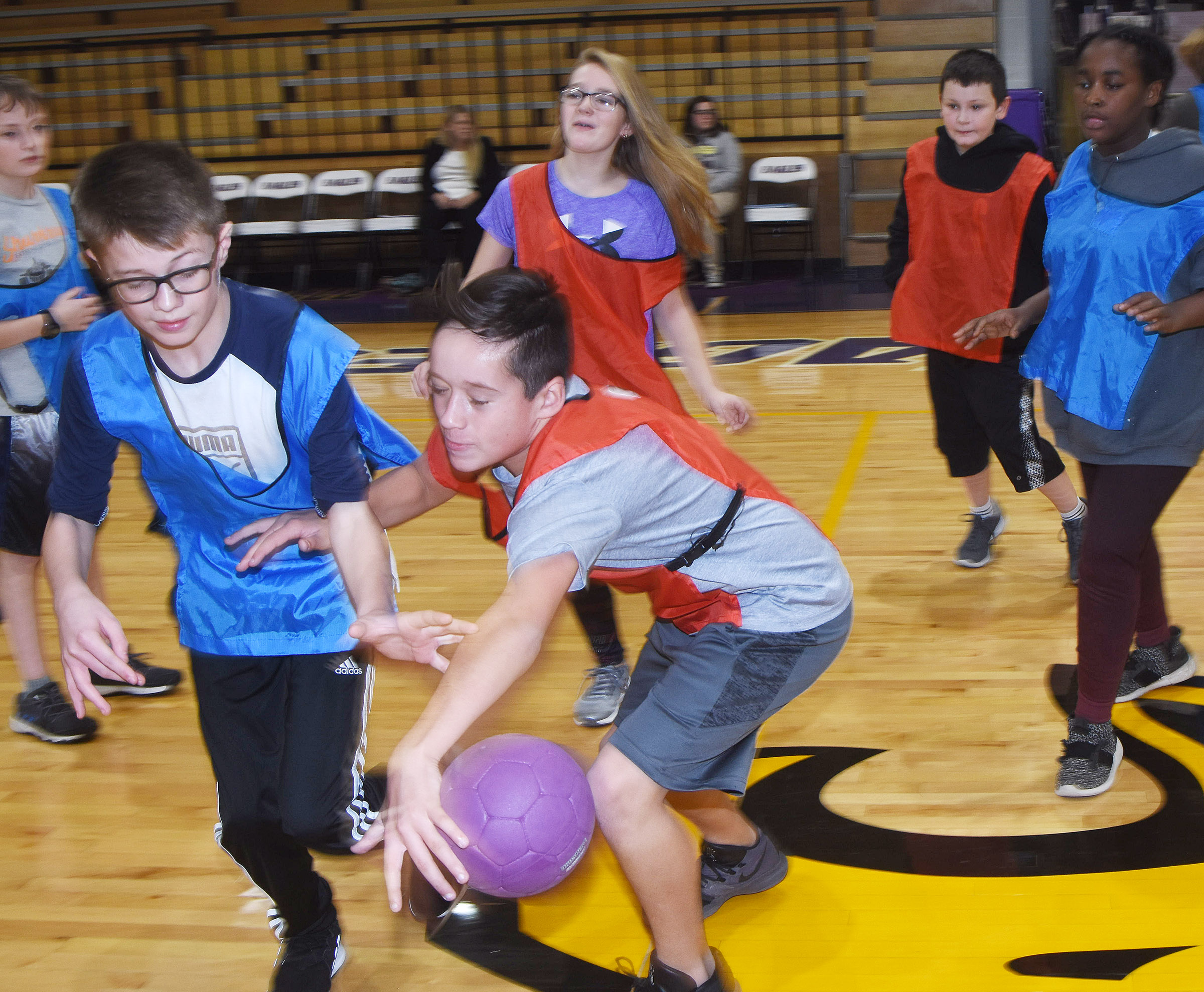 CMS sixth-grader Katon Cox protects the ball from classmate Ethan Murphy.