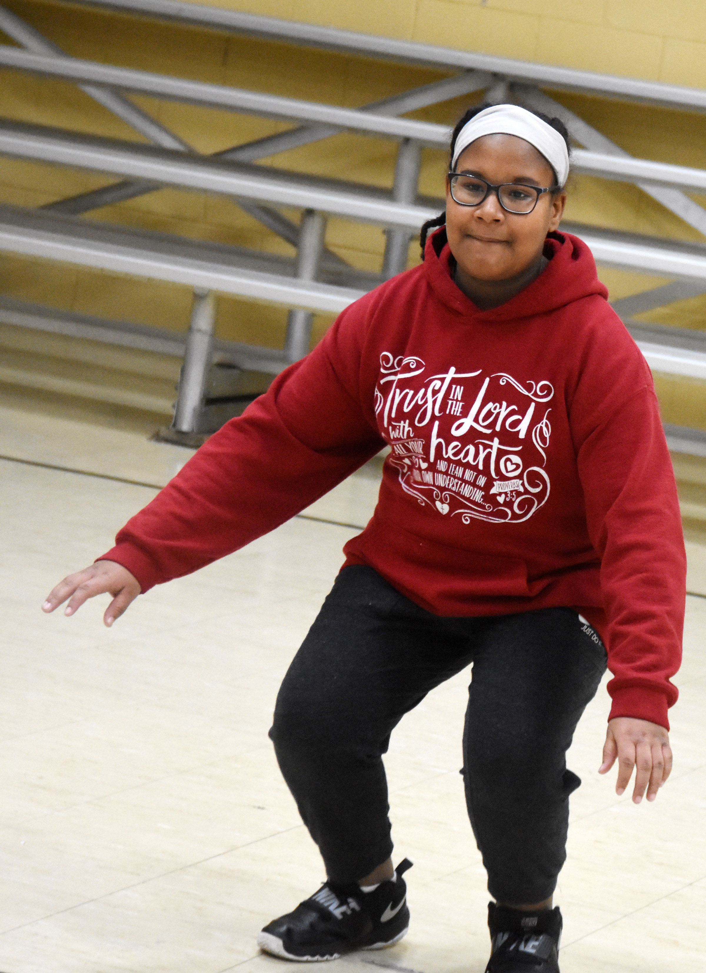 CMS sixth-grader KyAshia Mitchell performs a warmup exercise.